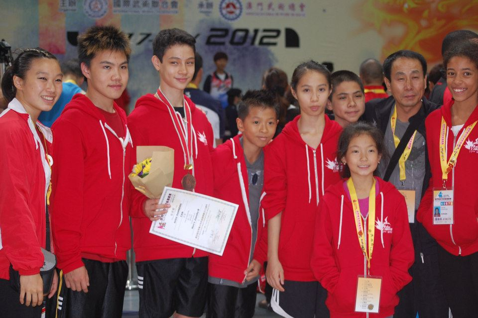 Master Wayland Li (second from right) with students Nima, Rex, Jennifer, Erica and other members of the Canadian National Wushu Team.
