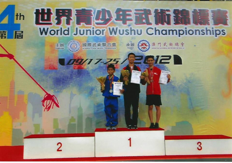 Nima accepting bronze at the 4th World Junior Wushu Championships, 2012.
