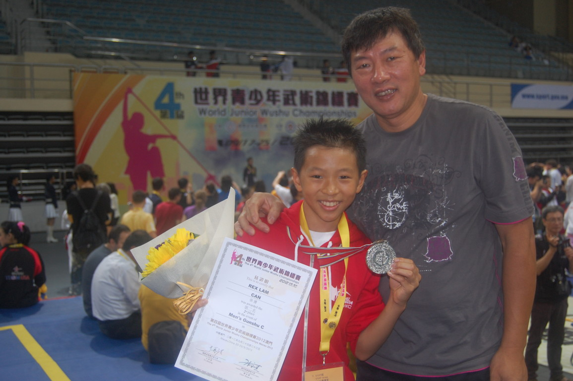 Rex and his dad, silver in Gunshu at the 4th WJWC in Macau, China.