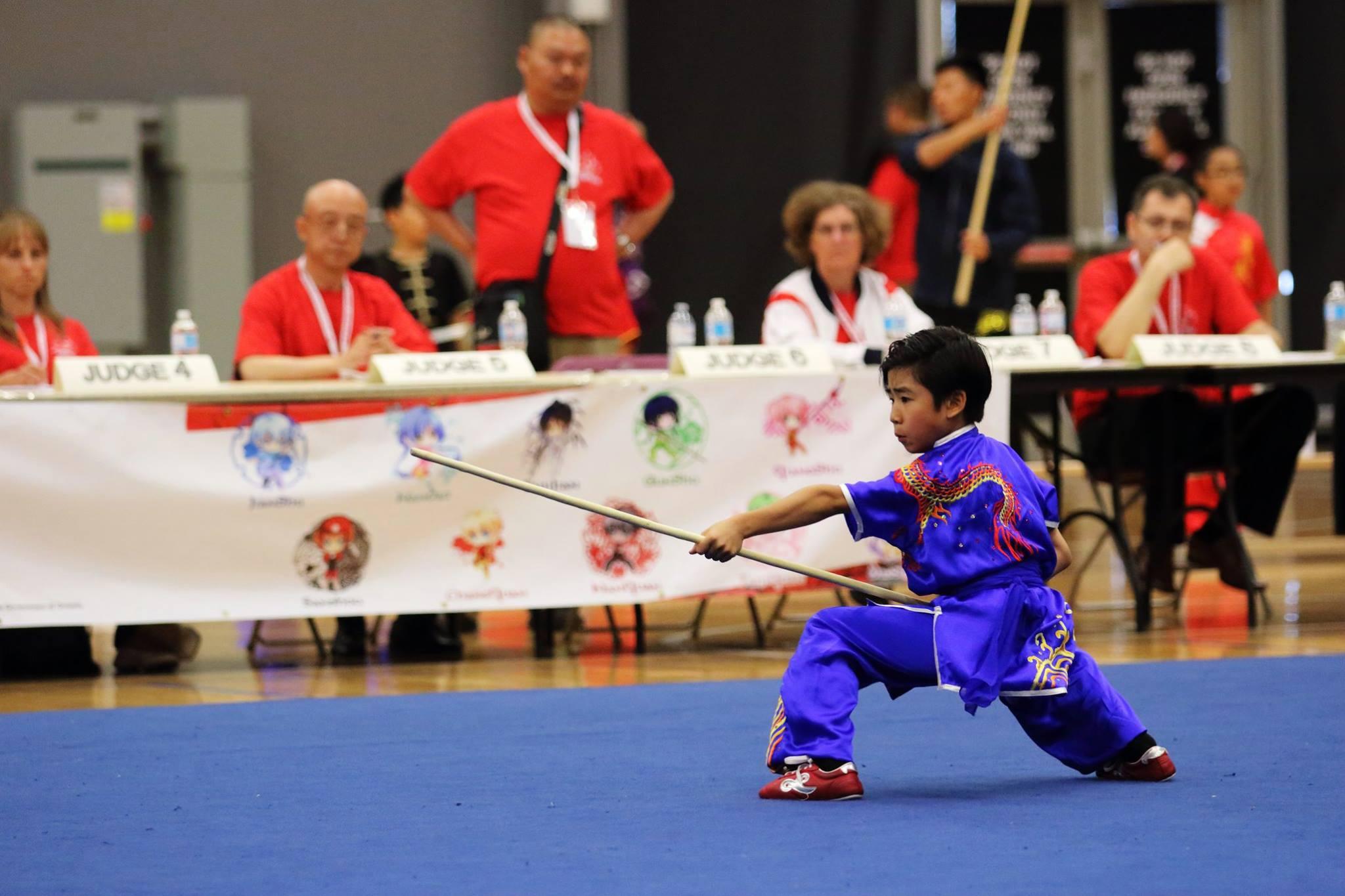 Kai-Hsin_Wayland_Li_Wushu_Staff_Gunshu_Canadian_National_Wushu_2016.jpg