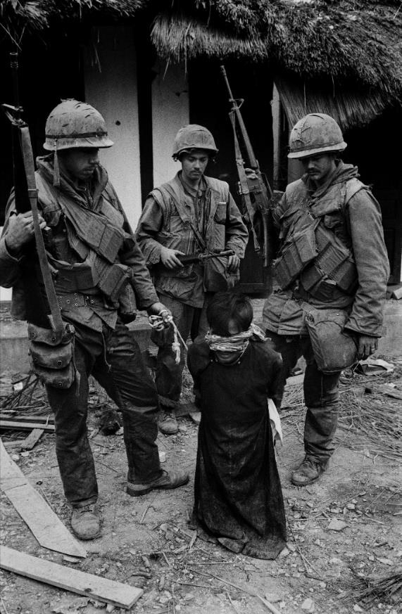 6. US Soldiers tormenting a civilian in the old city of Hue during the offensive, Tet, Hue, 1968.jpg