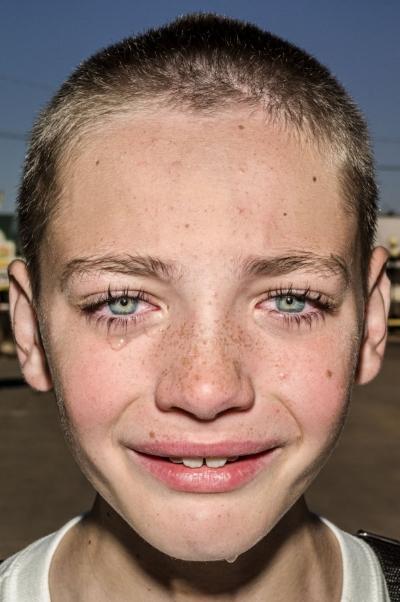 © Bruce Gilden, USA. Iowa. 2017. Nathen, a farm boy. Courtesy the artist/Magnum Photos
