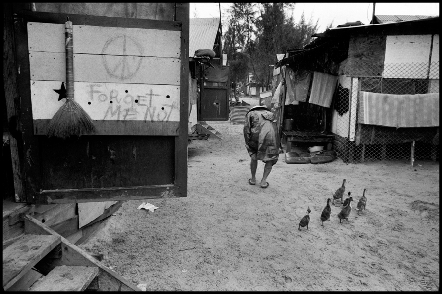 "A camp for refugees from the war. ""Forget ME Not"" is probably written by an American serviceman.  Da Nang, South Vietnam. 1973. © Abbas 