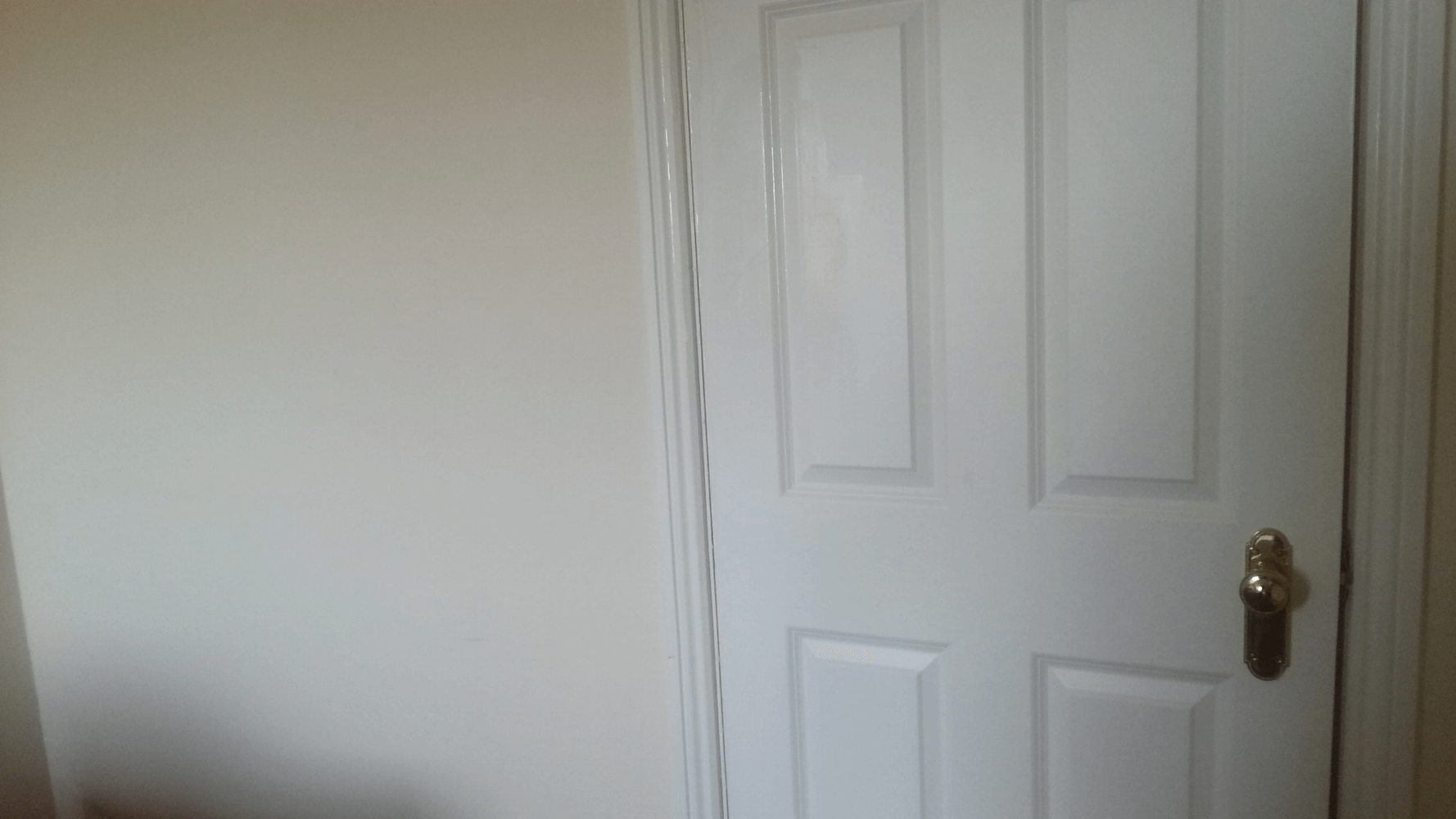Door in middle of wall leaving Hinge side exposed more