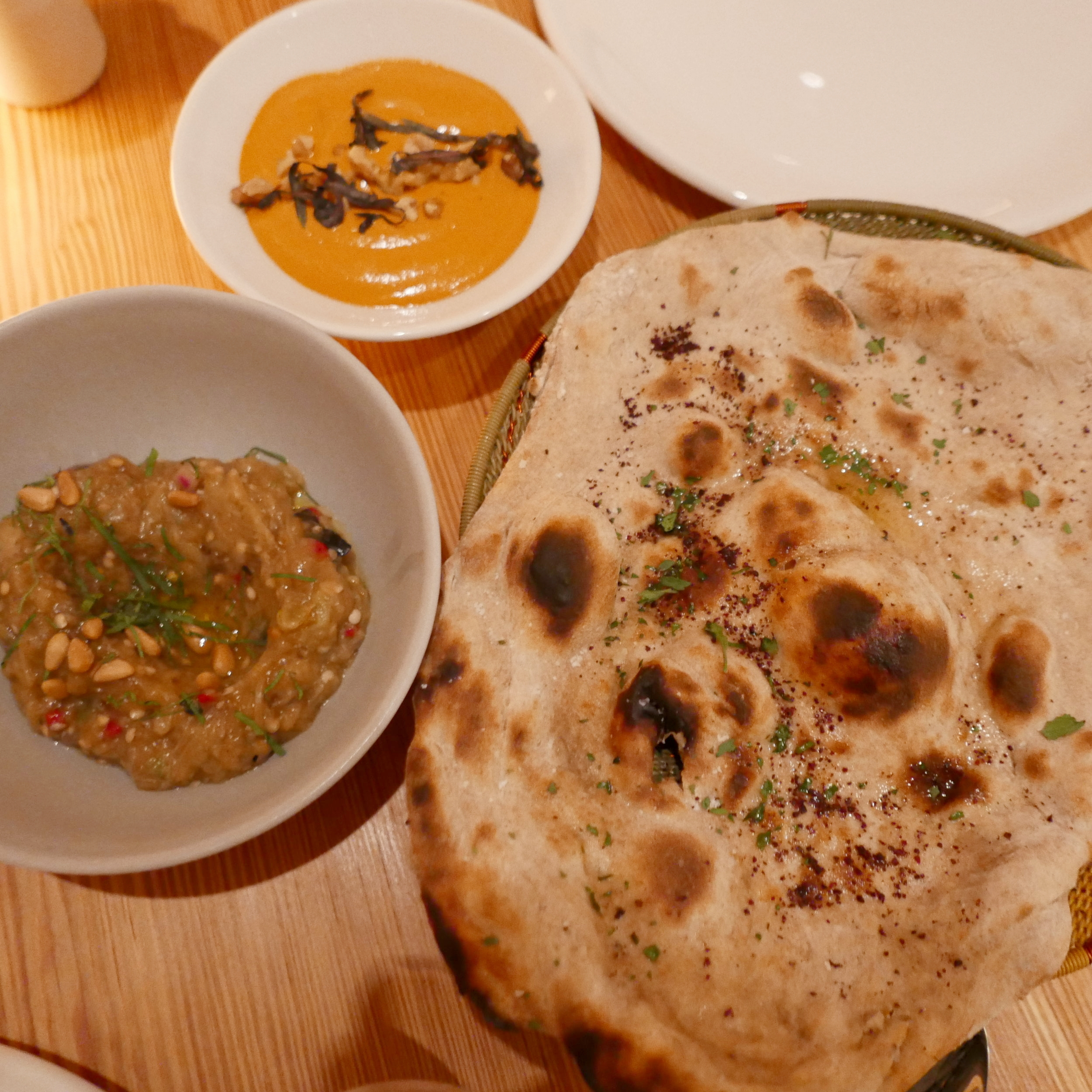 Red pepper & walnut and a Spiced eggplant, pine nuts dip with Tandoor Bread