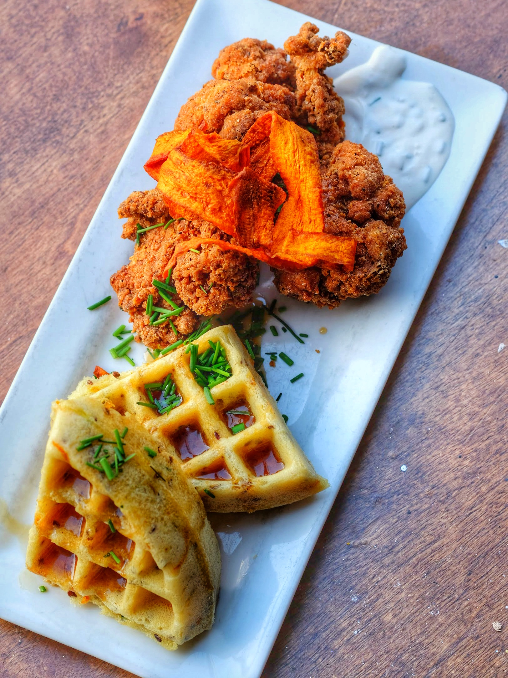 waffle with bourbon-brined **chicken-fried cauliflower - traditional style with bourbon maple syrup and chive creme fraiche and **carrot bacon