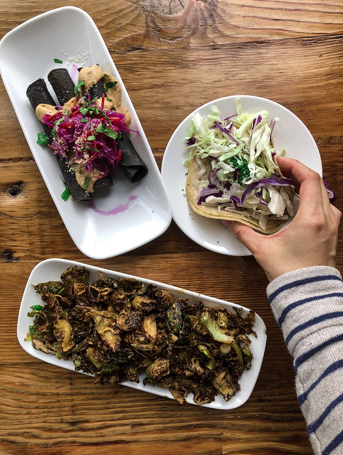 Assorted dishes from Seabirds:  Purple Taquitos, Burnt Brussels, Taco