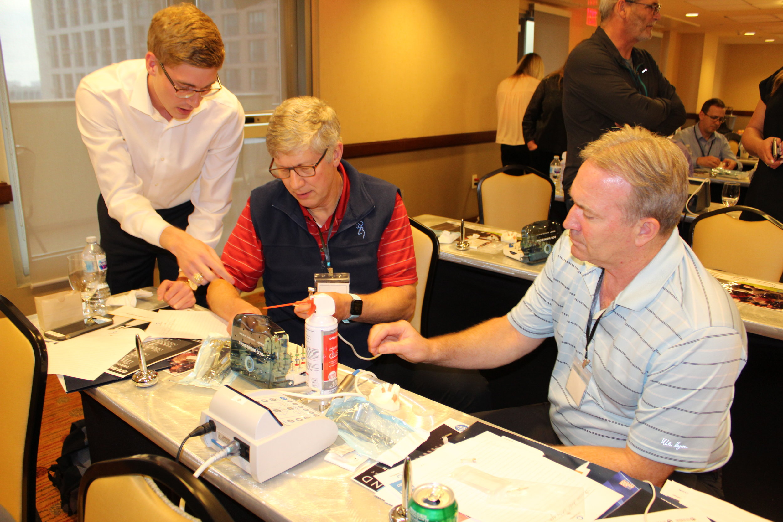 OCO Biomedical sales representative helping out during the hands-on workshop