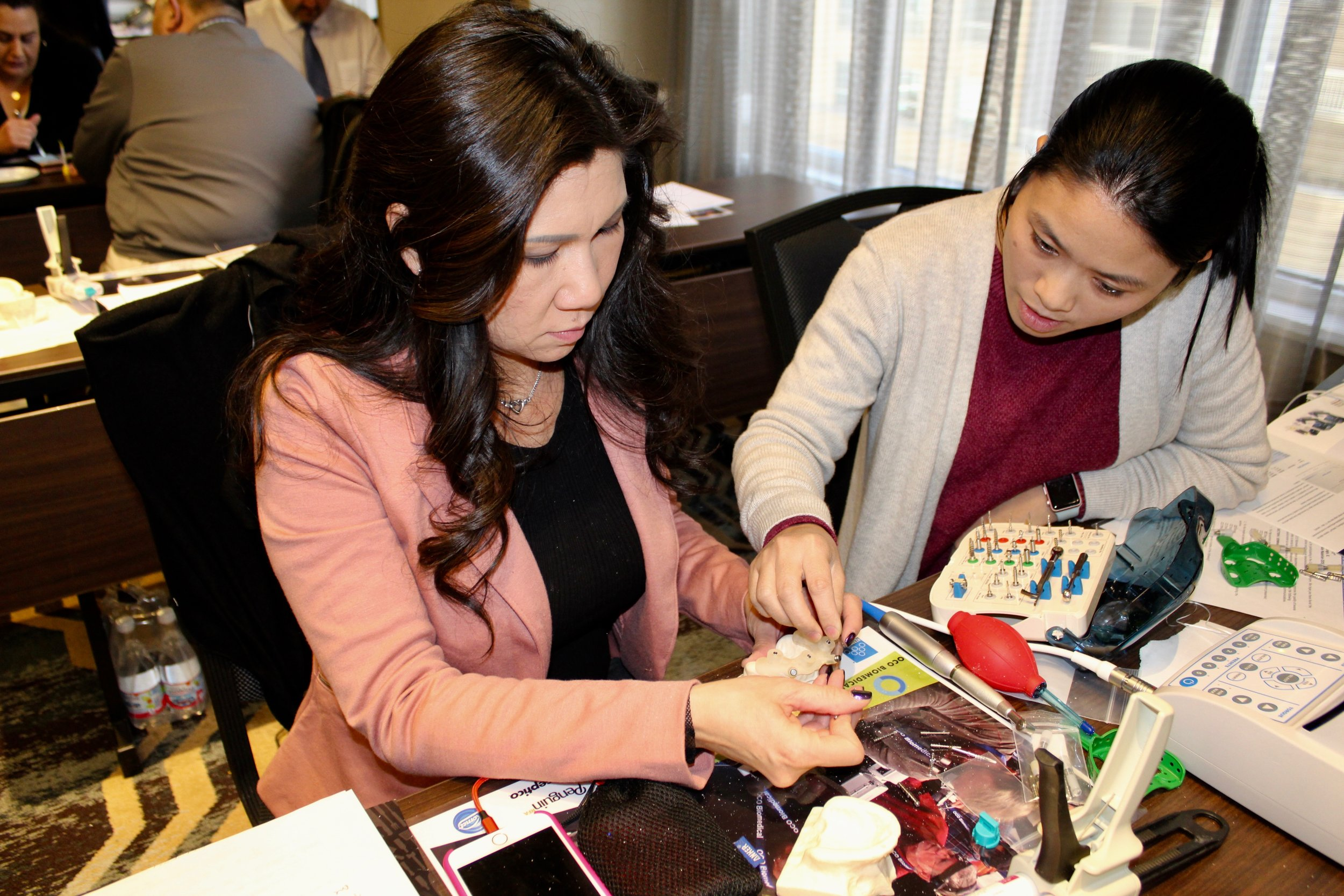Dr. Mary Tran, and her assistant Anh Phan during a hands-on workshop.