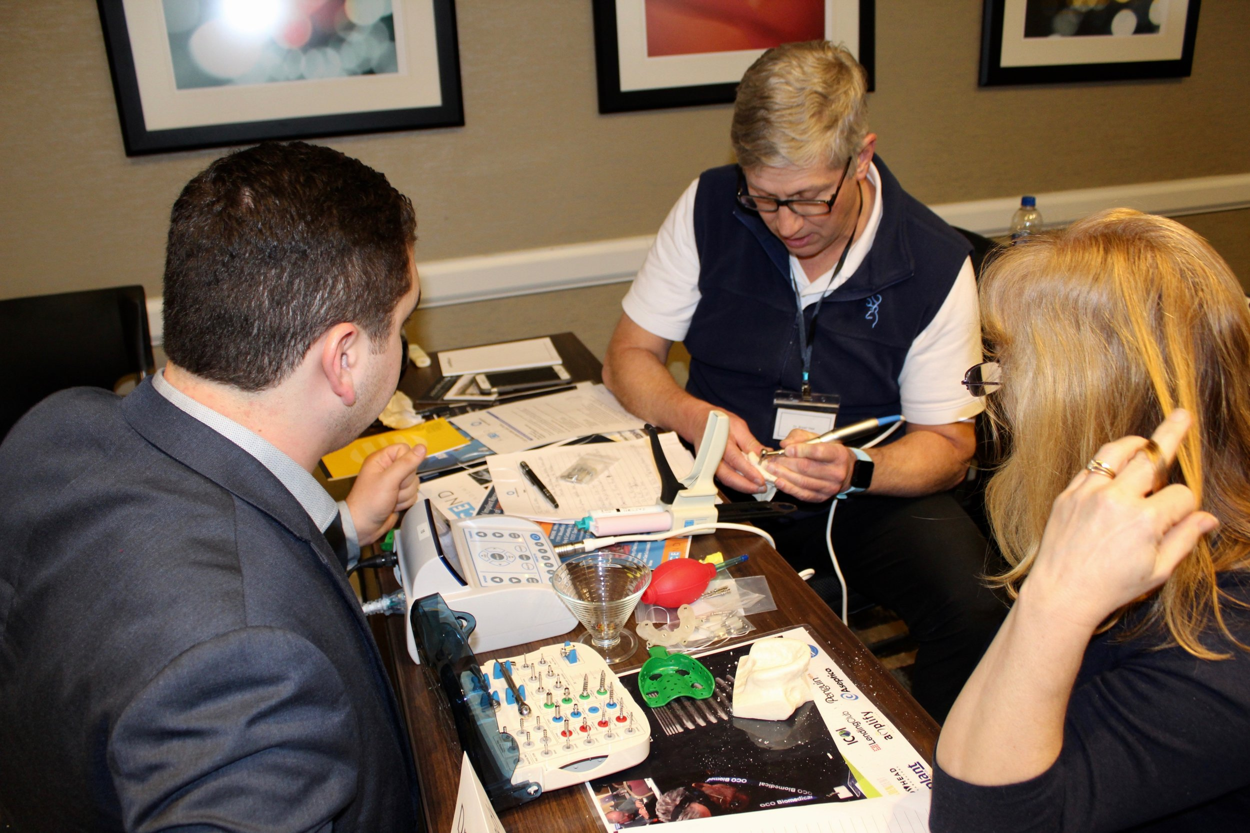 OCO Biomedical representative helping attendees during hands-on workshop