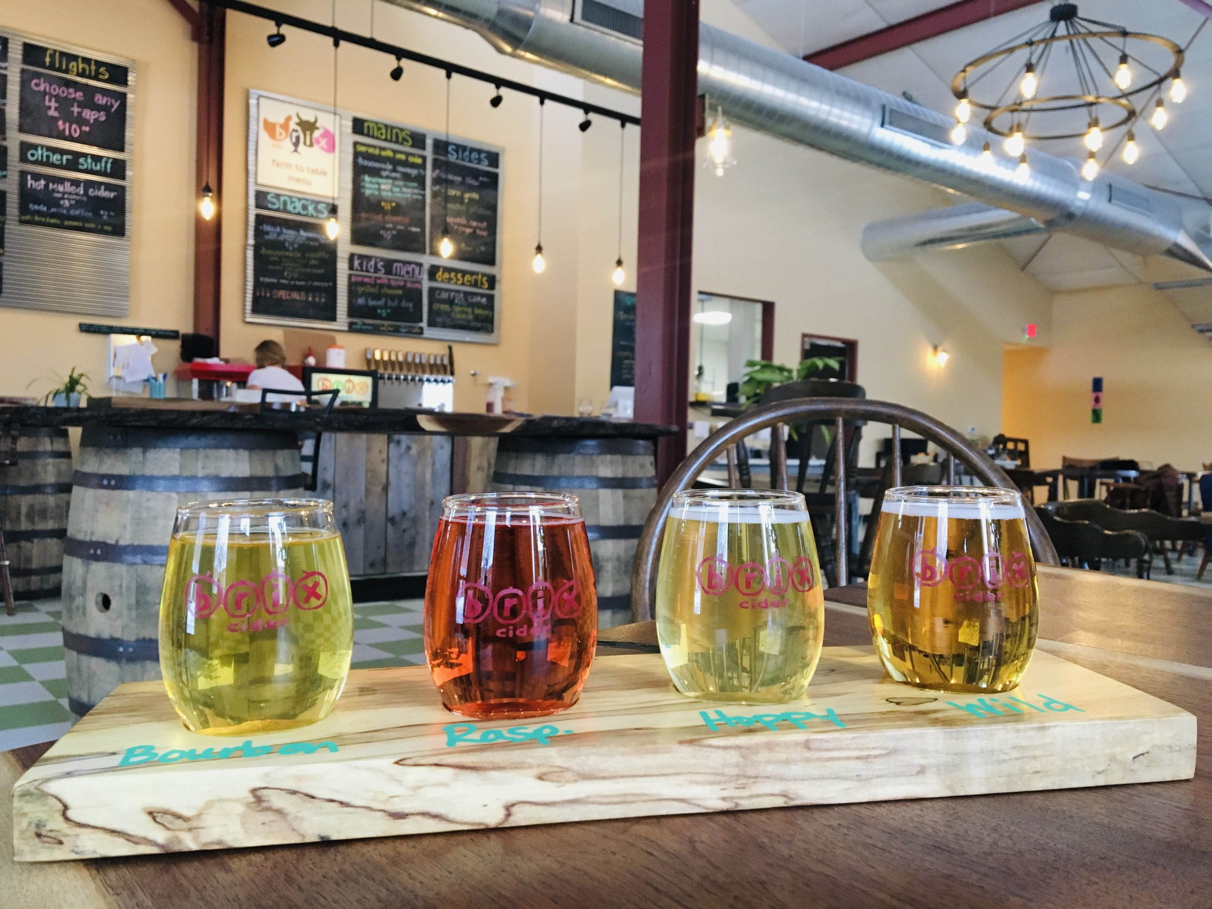 Above:  Inside the Brix Cider tasting room with a flight of cider