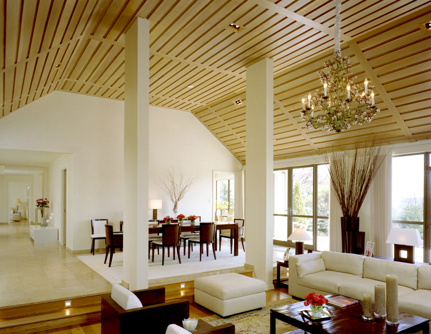 living:dining room with wood panel vaulted ceiling.jpg