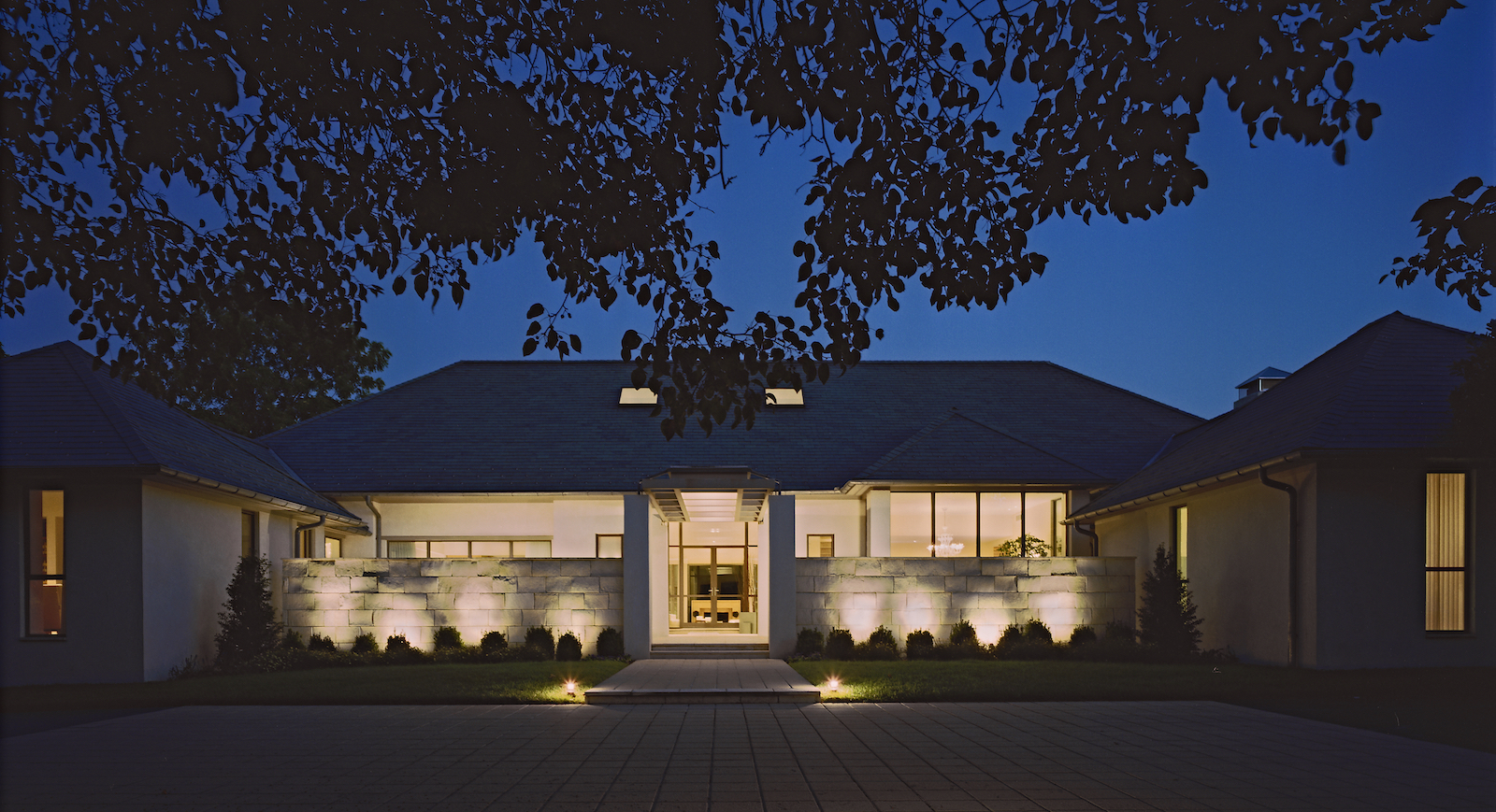 modern home in the evening with pot lights.jpg