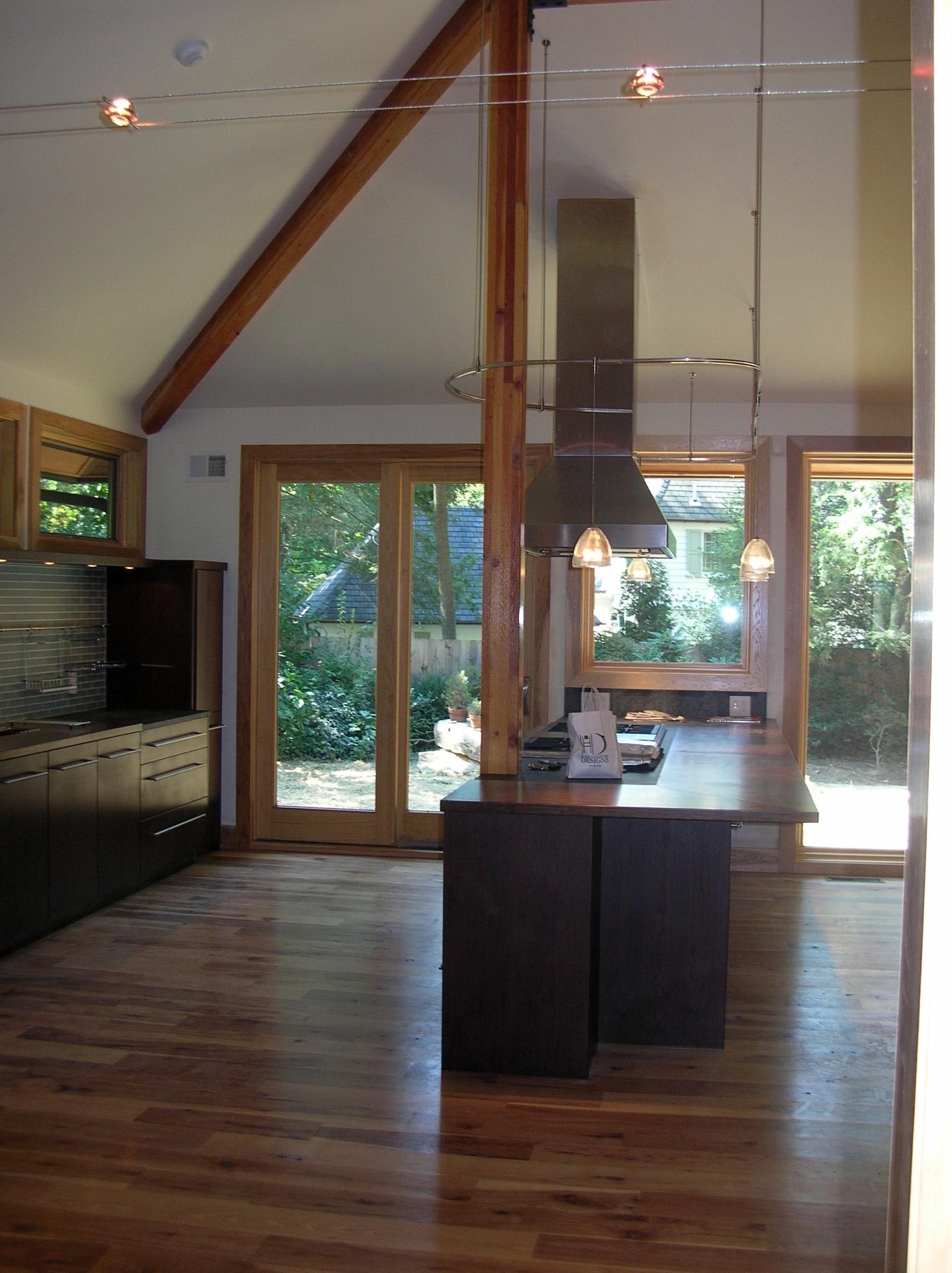 Price Kitchen Island Wood Flooring Island Rangehood Glass Backsplash Dark Wood Cabinets.jpg