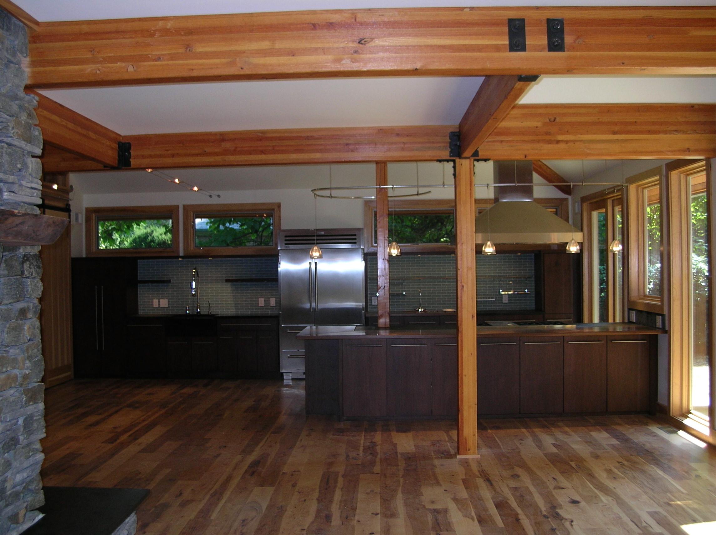 Price Kitchen with Dark Wood Cabinets Glulam Beams Glass Tile Backsplash Wood Flooring Pendant Lighting.jpg