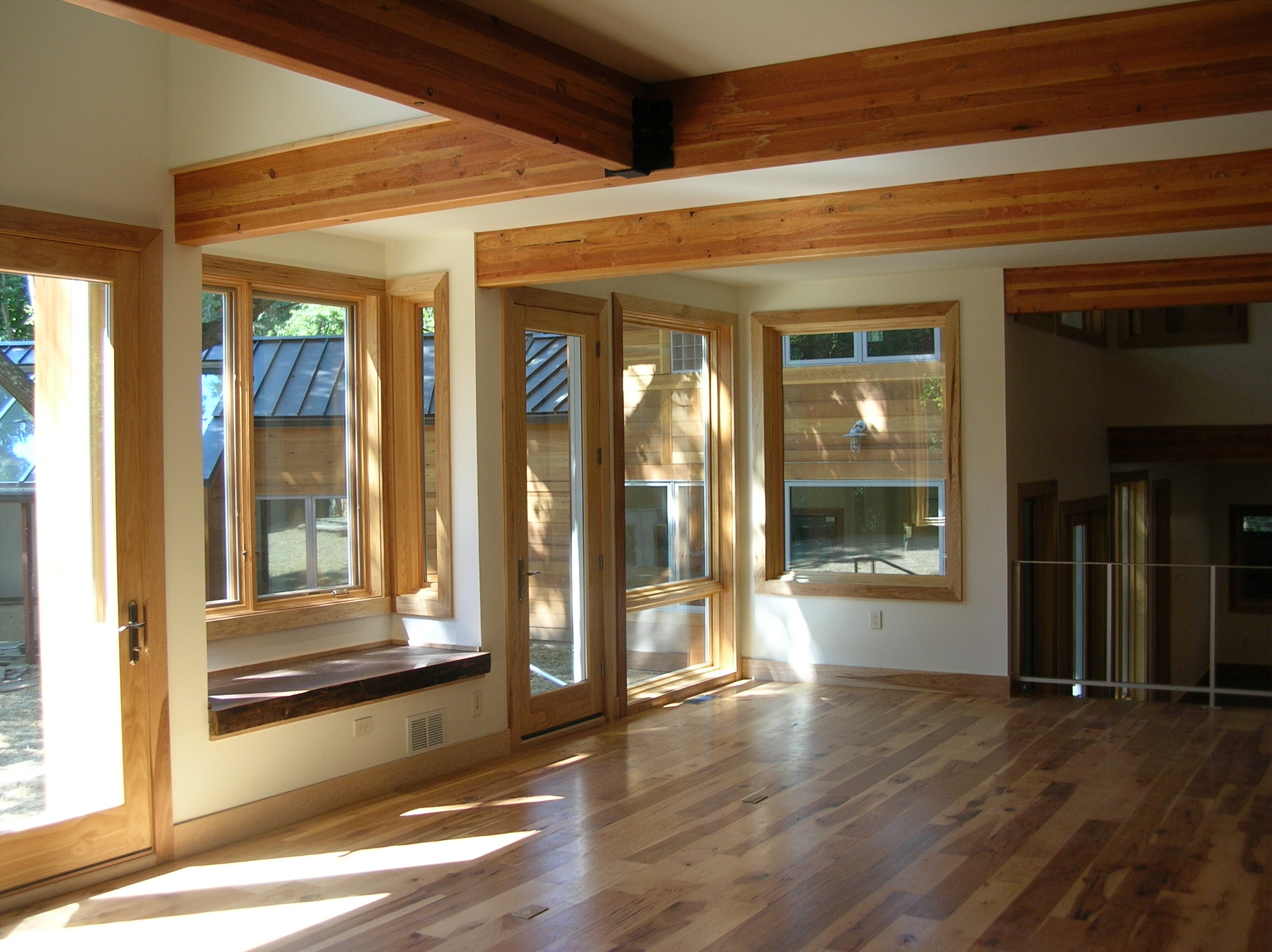 Price Living Room Wood Windows Wood Flooring Glulam Beams Metal Railing.jpg