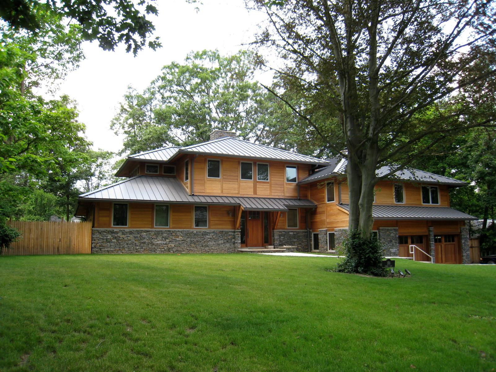 Price Modern Front Wood Siding Stone Base Metal Roof.jpg