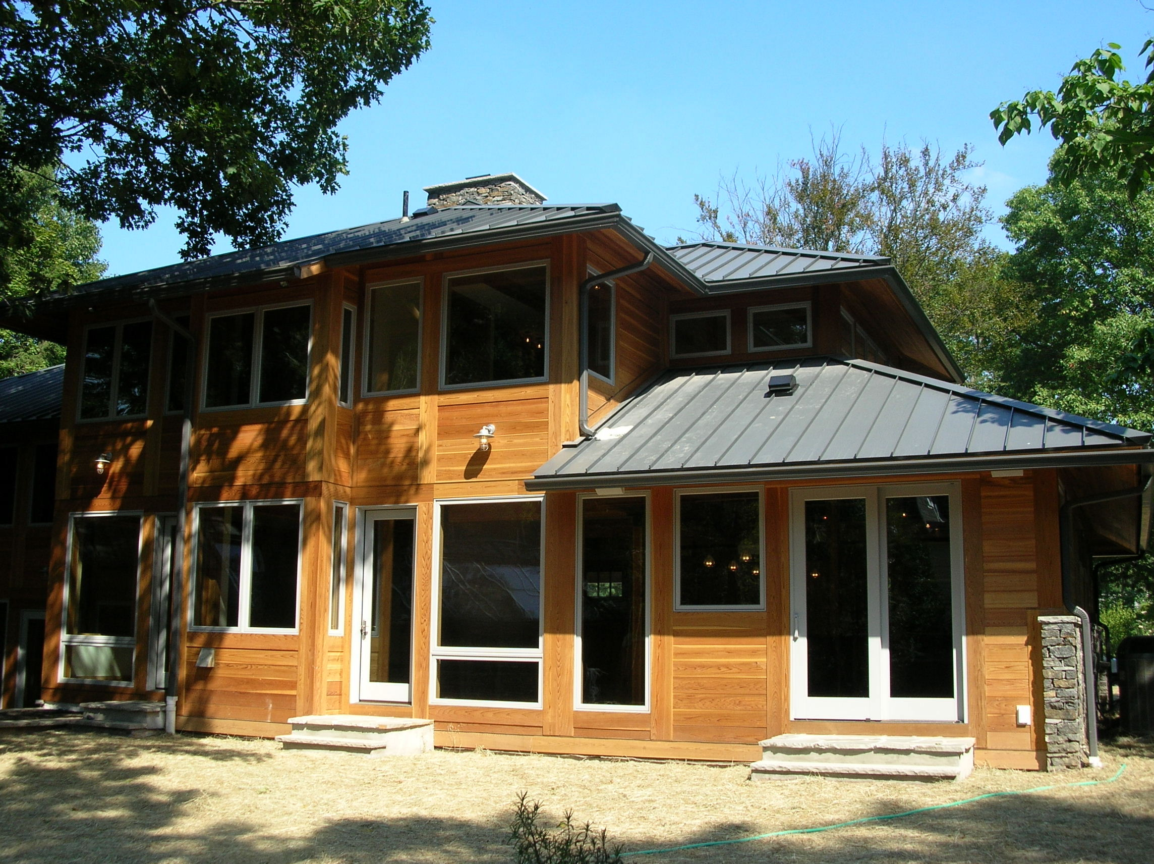 Price Rear Moden Front Wood Garage Doors Wood Siding Stone Base Metal Roof.jpg
