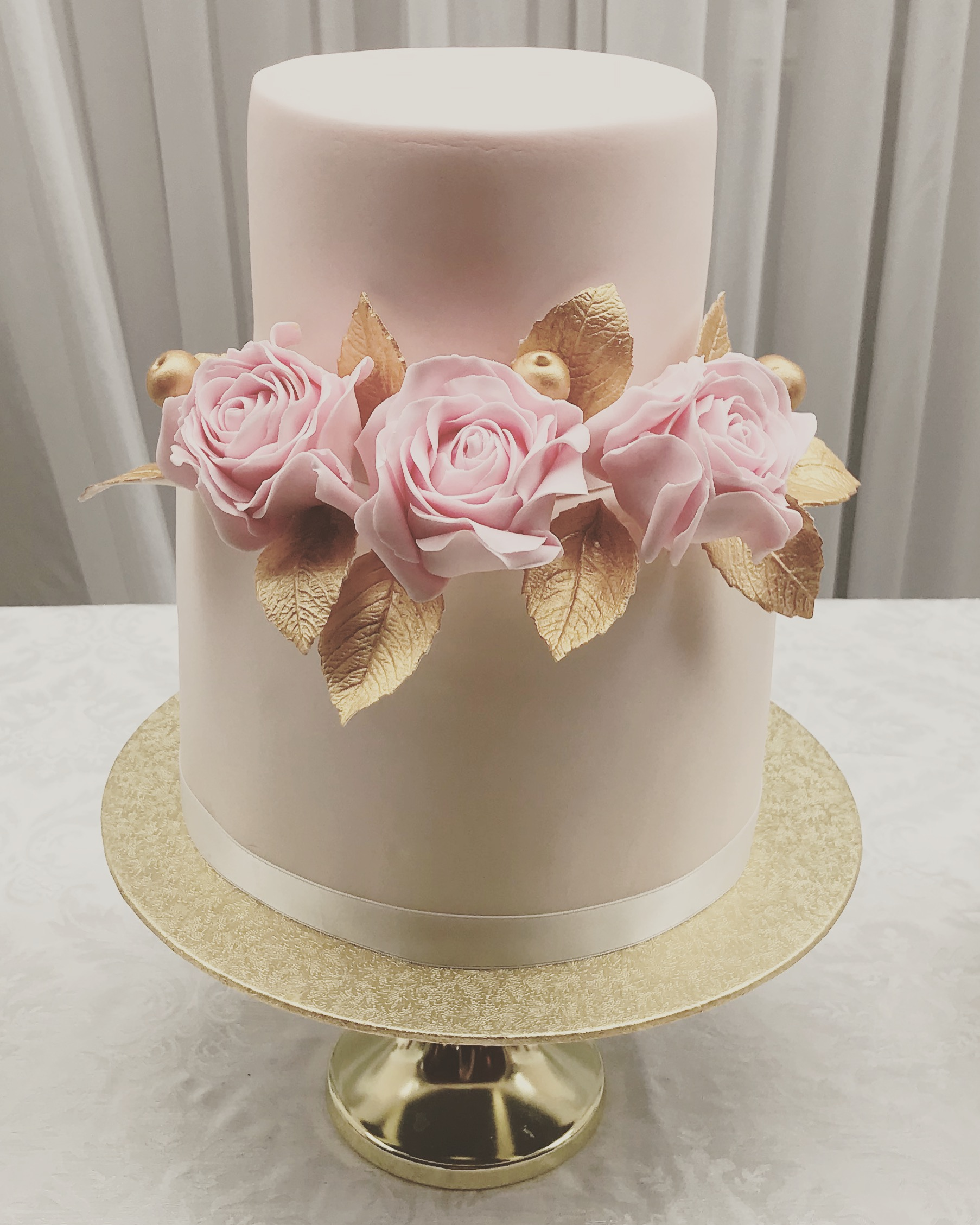 For the wedding cakes, a vintage theme provided lots of inspiration, from the classic art deco shapes to the vintage beading. I wanted a modern look so I used a lovely shade of pink pastel with touches of gold finished with some pink sugar flowers, gold leaves and berries.