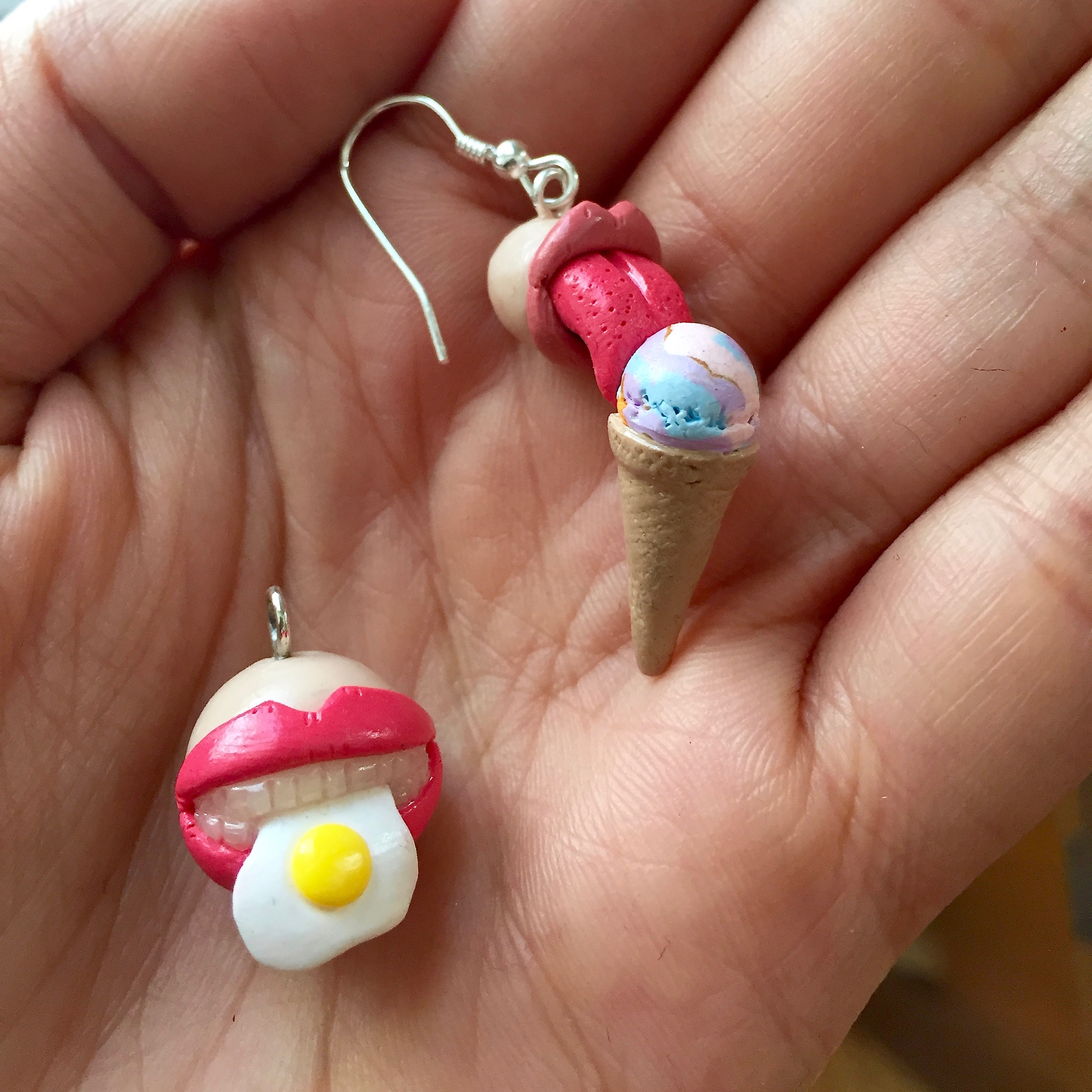 Polymer clay ice cream tongue lick earring and fried egg mouth charm by Small Things jewelry.