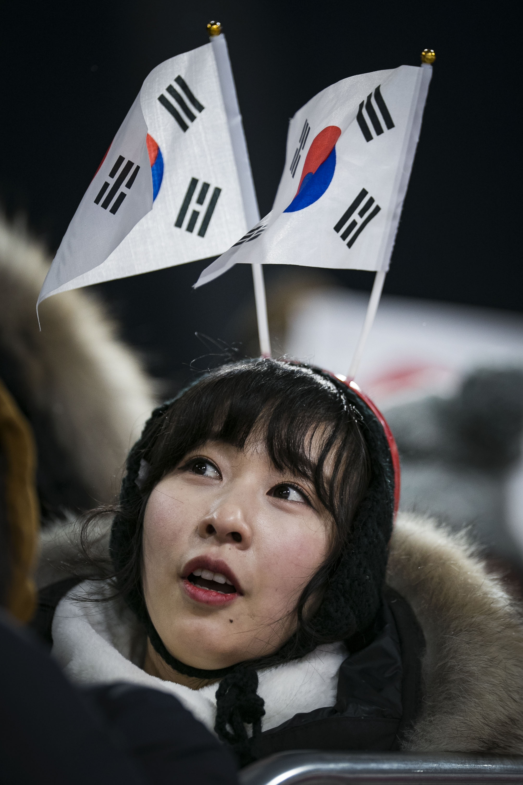 A South Korea fan watches ski jumping from the sidelines, Feb. 16, at PyeongChang Ski Jumping Center, South Korea during the 2018 Winter Games.