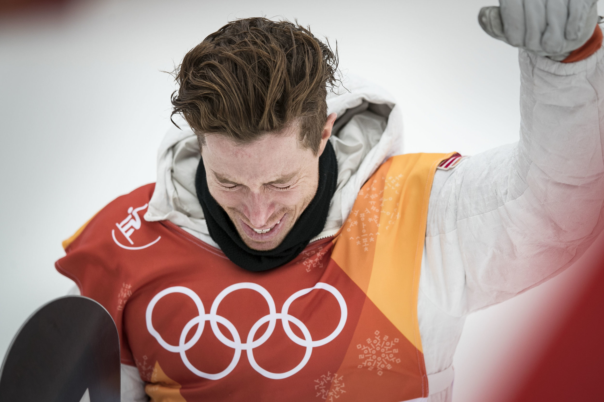 Halfpipe champion snowboarder Shaun White, cries tears of joy after seeing his score of 97.75 leading him to his third Olympic gold medal, Feb. 14 at Phoenix Snow Park. White broke into tears and hugged his friends and family before the venue celebration.