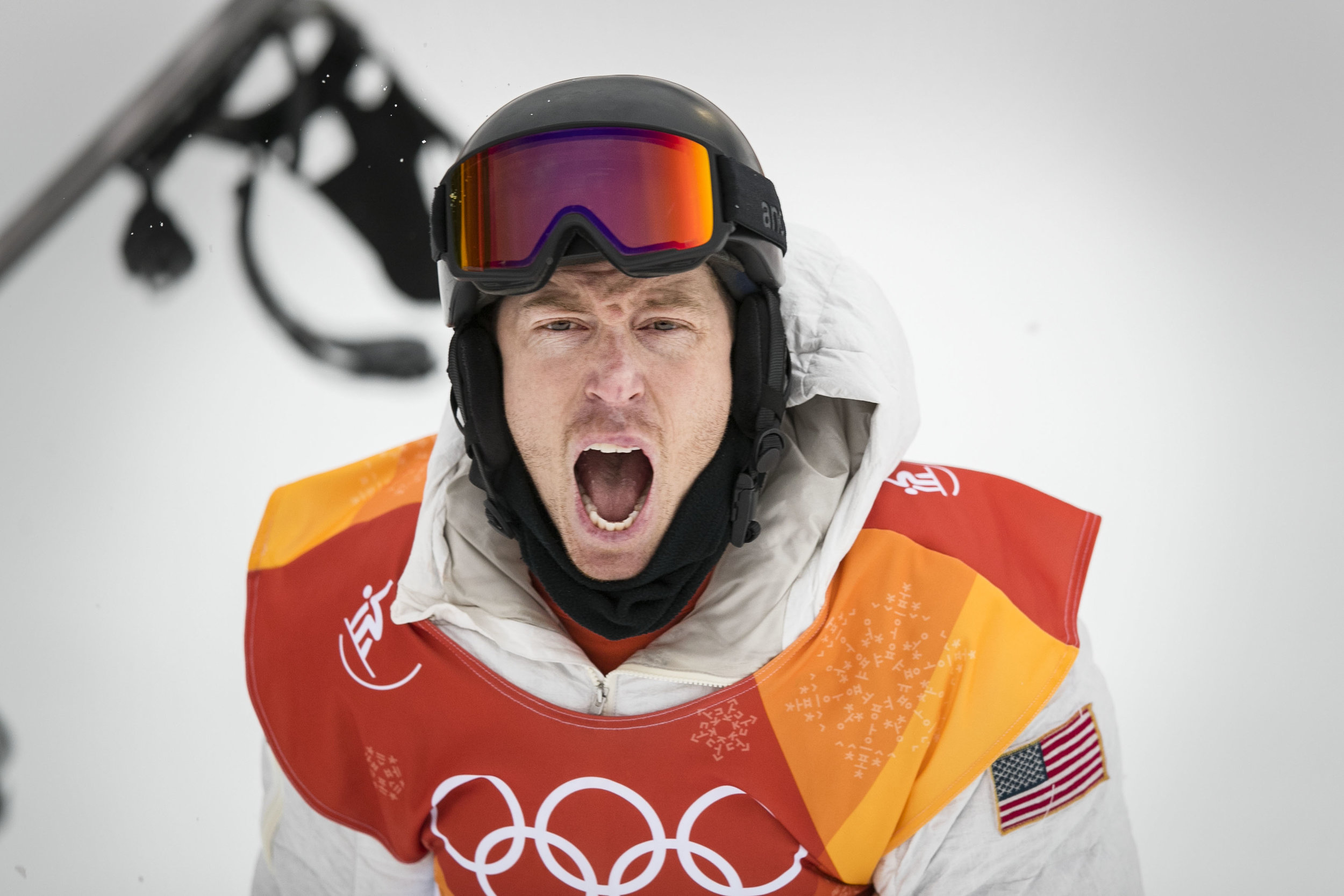 Halfpipe champion snowboarder Shaun White, throws his board and screams in excitement after seeing his score of 97.75 leading him to his third Olympic gold medal, Feb. 14 at Phoenix Snow Park. White broke into tears and hugged his friends and family before the venue celebration.