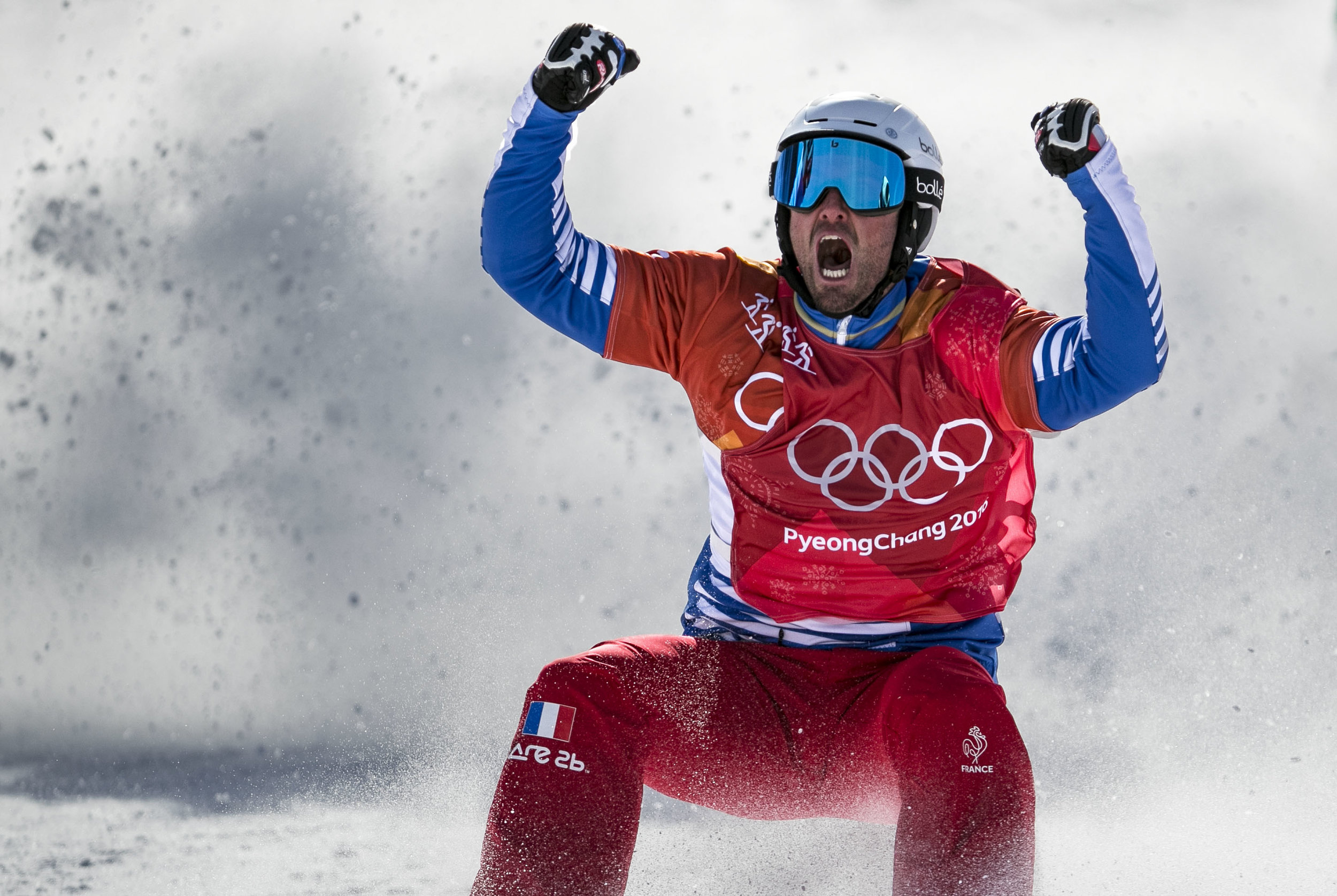 Back-to-back Olympic champion, France's Pierre Vaultier, roars in excitement after securing his gold title in Men's Snowboard Cross, Feb. 15, Phoenix Snow Park. The motocross like mash up of six snowboarders and a mix of obstacle courses, the Olympic event Snowboard Cross features a little bit of everything and Vaultier continues to hold the gold.