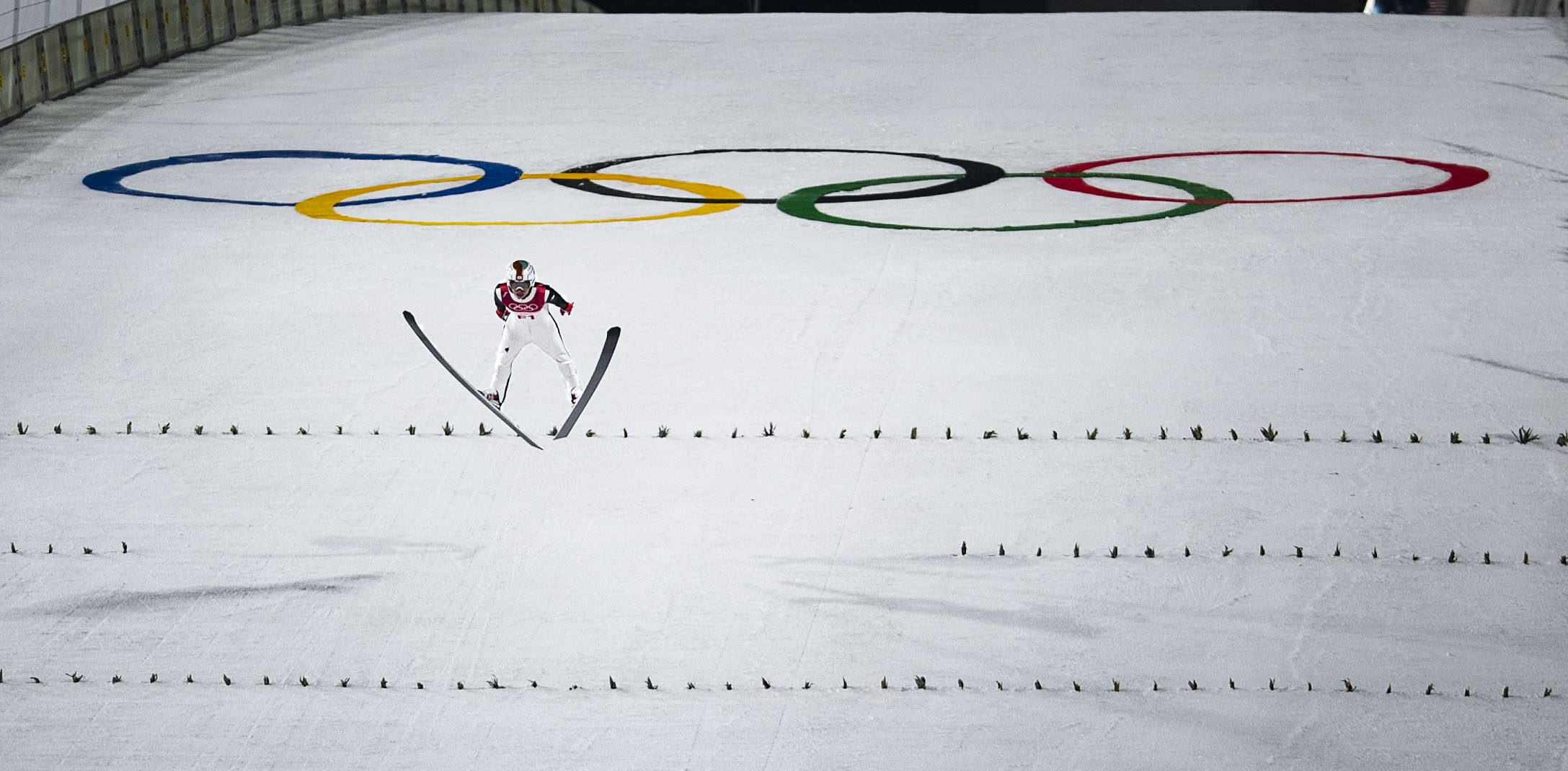 A ski jumper lands on the hill at PyeongChang Ski Jumping Center, South Korea, Feb. 16 during the 2018 Winter Games.