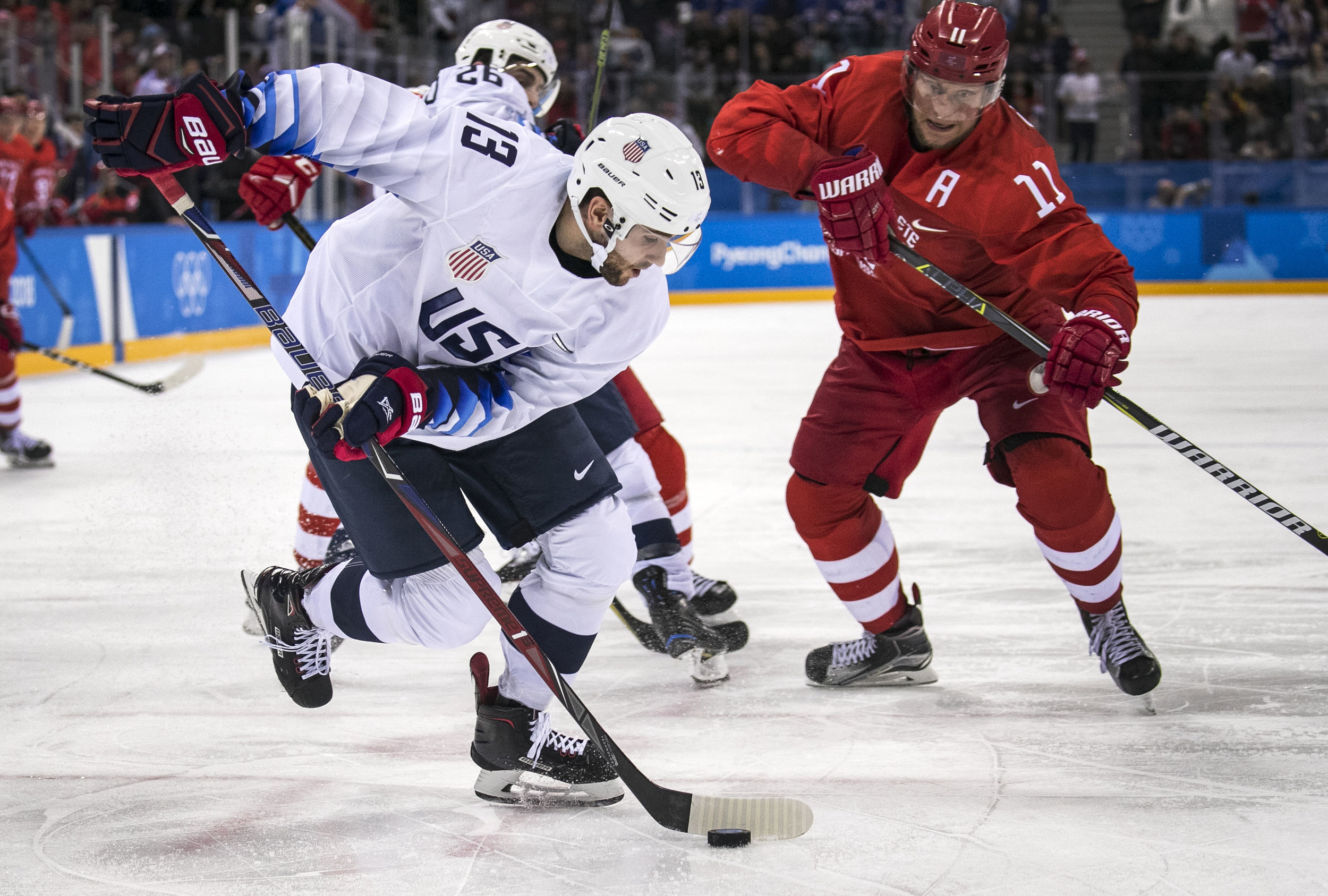 U.S. men's hockey team, forward Ryan Gunderson, retrieves the puck to score against the Olympic Athlete's of Russia, Feb. 17, at Gangneung Hockey Centre. U.S. lost, 4-0 in a shut out against the Olympic Athlete's of Russia. Grace Hollars, BSU at the Games