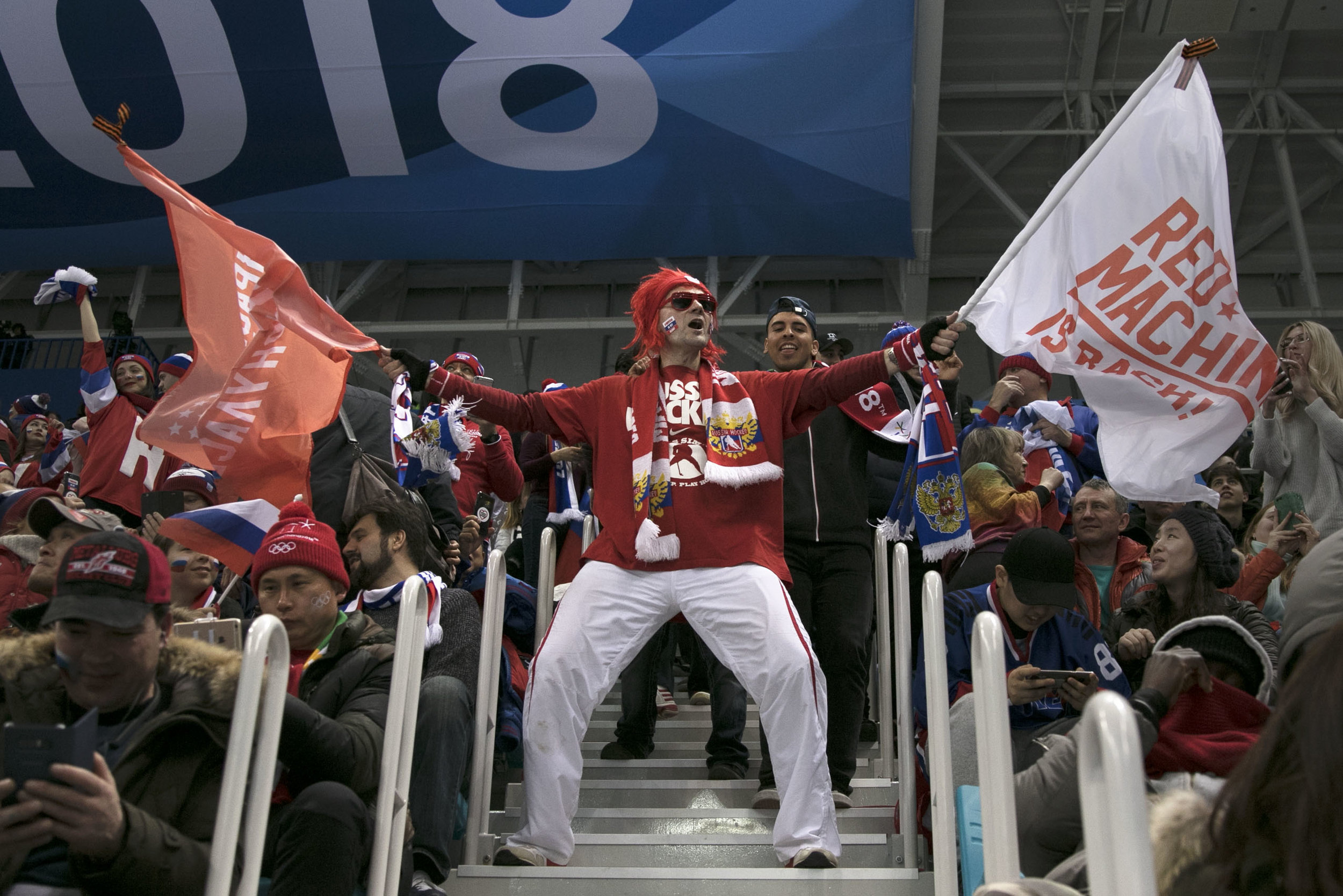Olympic Athlete's of Russia fans wildly cheer after after scoring in the second period against the U.S., Feb. 17, at Gangneung Hockey Centre. U.S. lost, 4-0 in a shut out against the Olympic Athlete's of Russia.