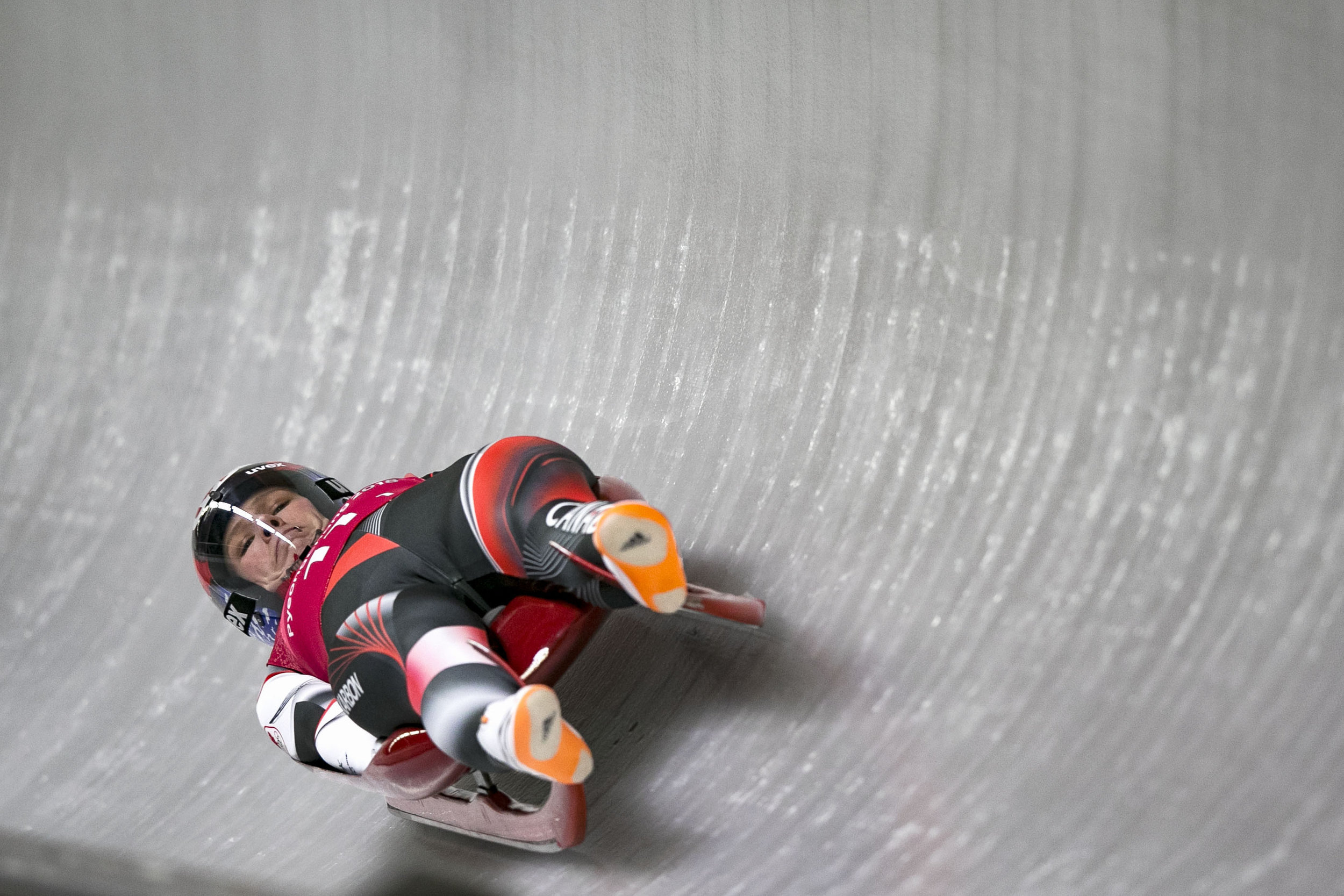Canada's relay team luger Alex Gough, searches for the target as she slides around the final corner, Feb. 15 at Alpensia Sliding Centre, PyeongChang, South Korea. Canada's relay team of Alex Gough, Sam Edney, Tristan Walker, and Justin Snith won sliver with a final time of 2:24.872, all the way down to one hundredth of a second made the difference between, first and second place.
