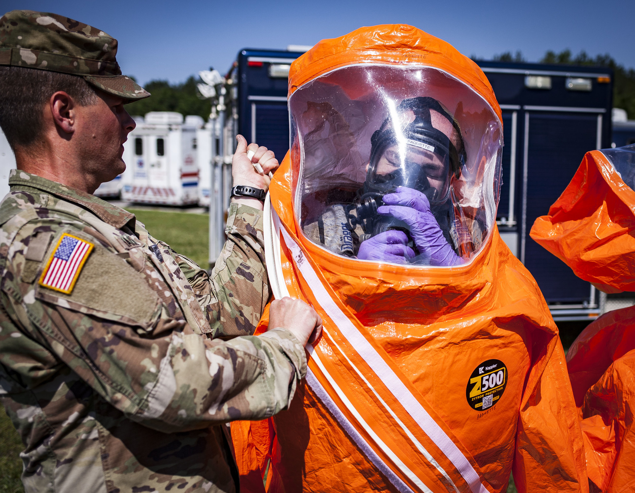 Stg. 1st Class David Paquette of the Virginia National Guard's Fort Pickett-based 34th Civil Support Team, straps on his boots and hazmat suit for the second day of the two day Training Proficiency Evaluation, Thursday, May 24, Richmond, VA. The training is to check the unit's level of readiness to assist firstresponders in potential biological chemical, nuclear, radiological and explosive incidents. Photos for Richmond Times-Dispatch