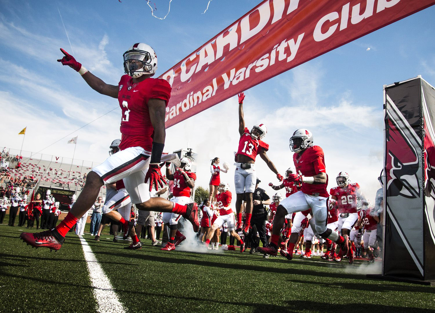 Ball State players rush on to the field through smoke and confetti for the homecoming game against Central Michigan, Oct. 21 at Scheumann Stadium. Ball State lost to Central Michigan, 9-56.  Photos for Ball State Daily News