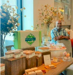 Sam was inspired by his passion in soap-making and scent memory to leave the corporate world behind to open his own business. He wanted to find a way to make environmentally friendly products that smell fantastic, so he started experimenting in soap-making. His dedication to his family, the community and the environment led him to opening Distinct Bath & Body and now he wants to share his passion with Six Corners!
