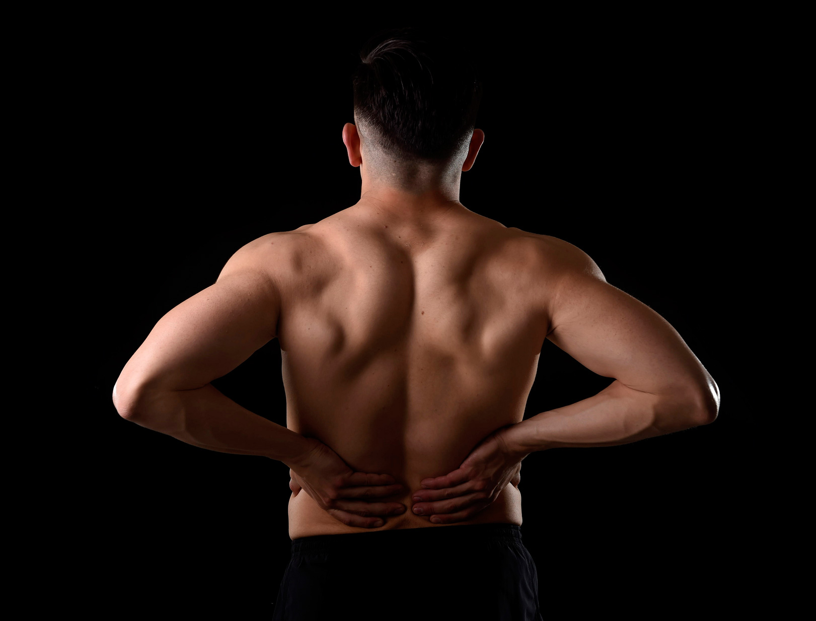 photodune-15841375-young-muscular-body-sport-man-holding-sore-low-back-waist-are-suffering-pain-in-athlete-stress-07-m.jpg