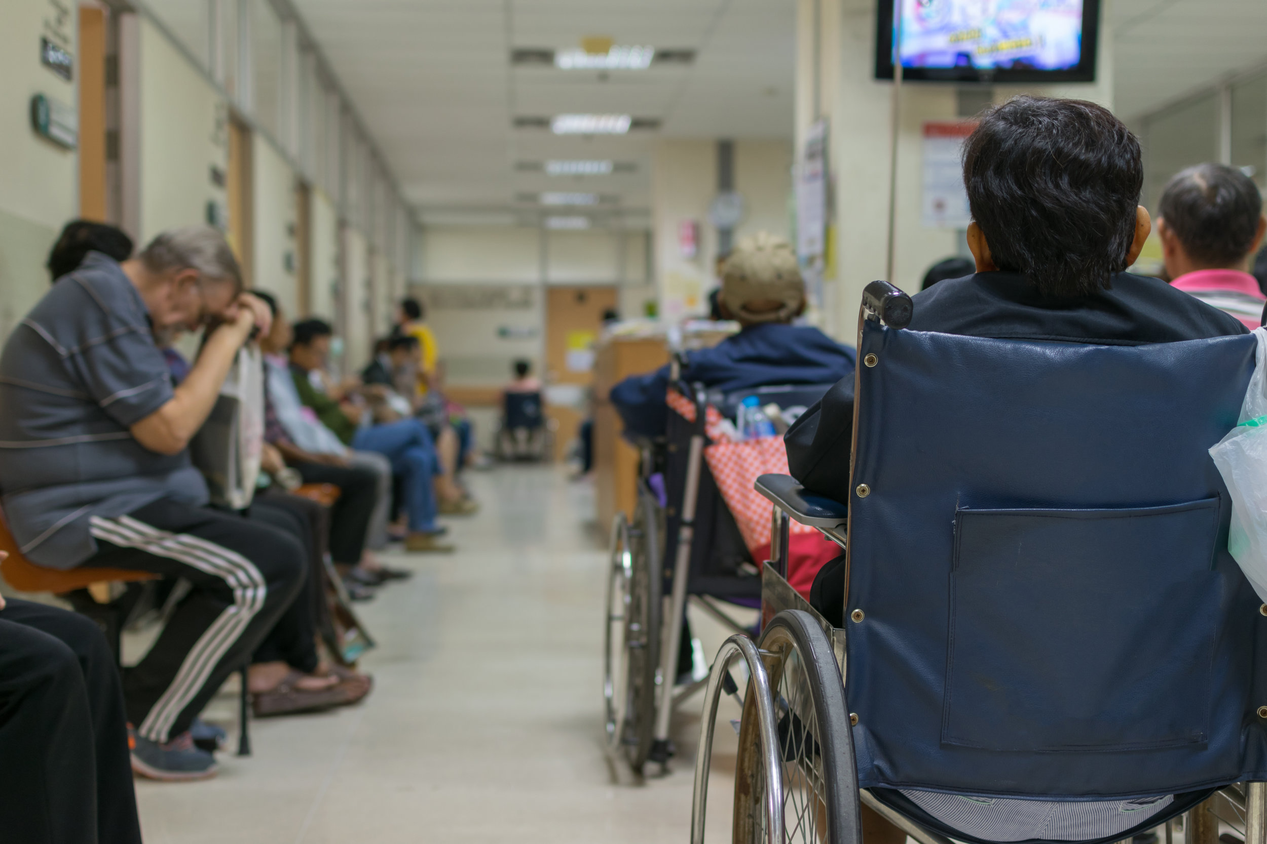 A room packed with tired patients waiting to see their primary care provider
