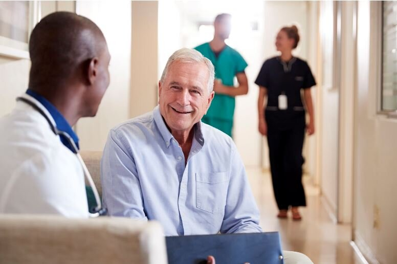 Primary care physician meeting with a patient at a regular doctor appointment