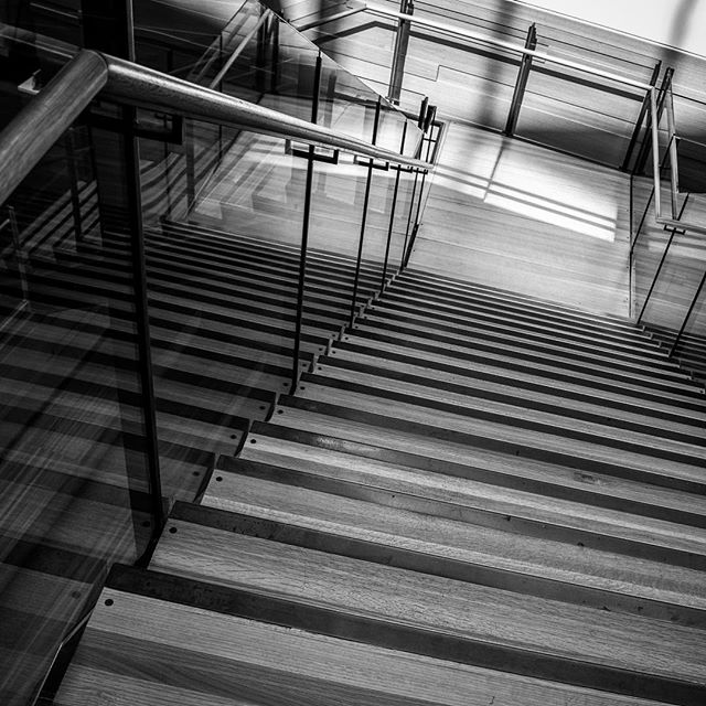 Path to Enlightenment. Shot in the new Austin Central library before I was told no professional photos. Still not sure how I feel about that, but it's beautifully built. #AustinCentralLibrary #CentralLibrary #DowntownLibrary #BlackandWhitePhotography #BandWPhotography #ArchitecturePhotography #ArchitecturalPhotography #PathtoEnlightenment #Stairs #Stairway #Reflection