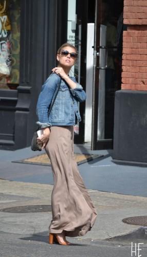 girl in wide legged jumper wooden high heels denim jacket sunglasses