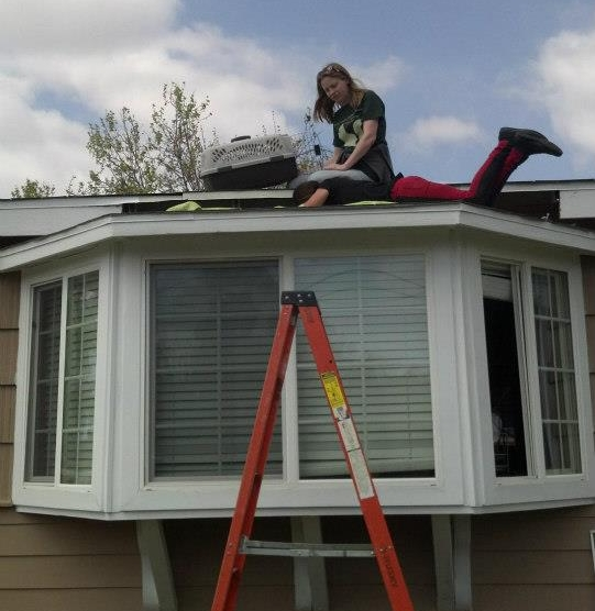 Amber and Aundrea pulling kittens out of a roof. There are not a lot of rescues that would do this -we don't hesitate.