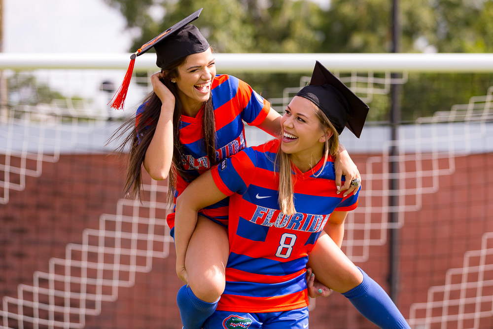Group grad photo session featuring Jessie Holmes and Cassie Owens on Thursday, April 26, 2018 at Donald R. Dizney Stadium in Gainesville, FL / Photo by Matt Pendleton for Matt Pendleton Photography.