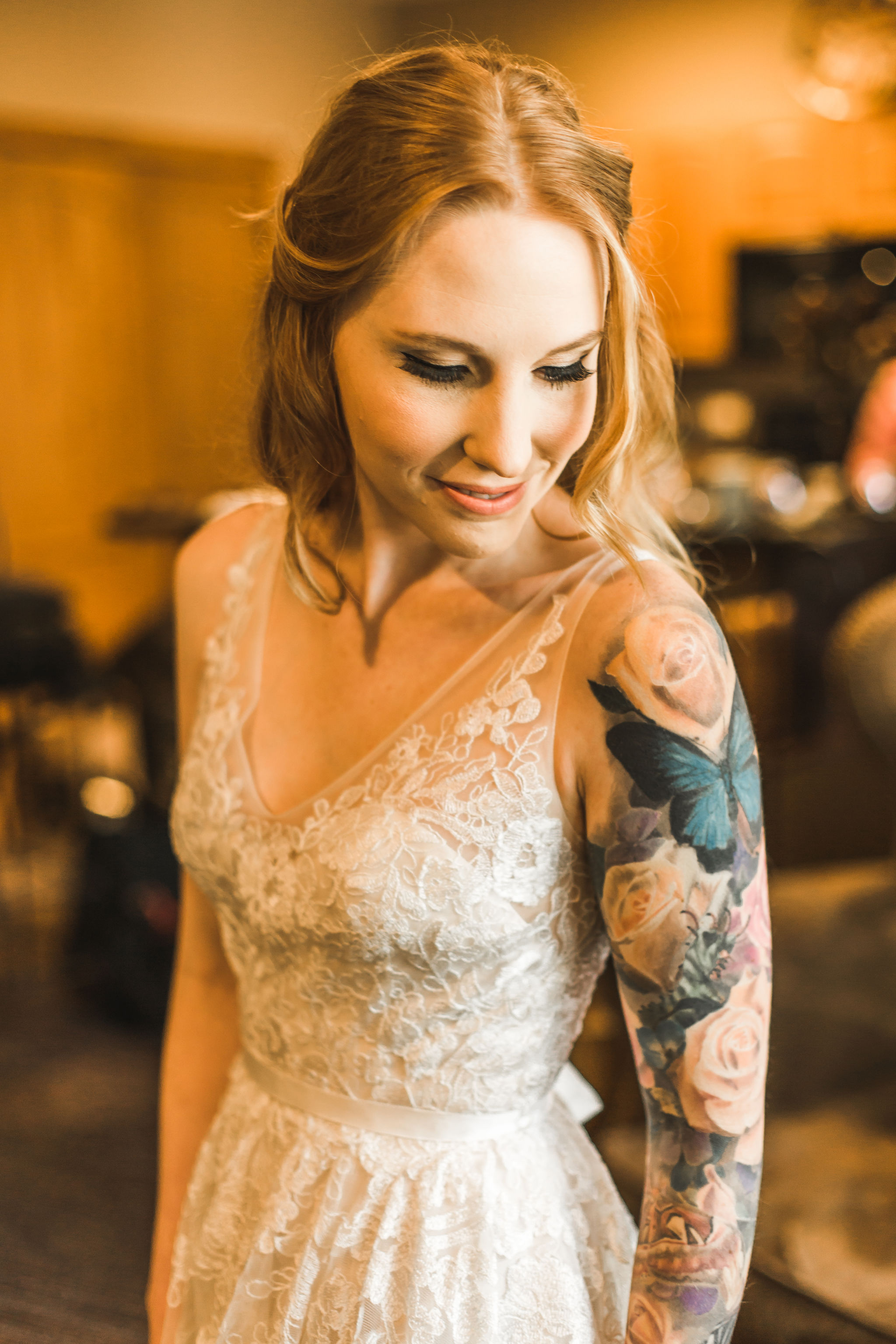 Bride with tattoos lace wedding dress