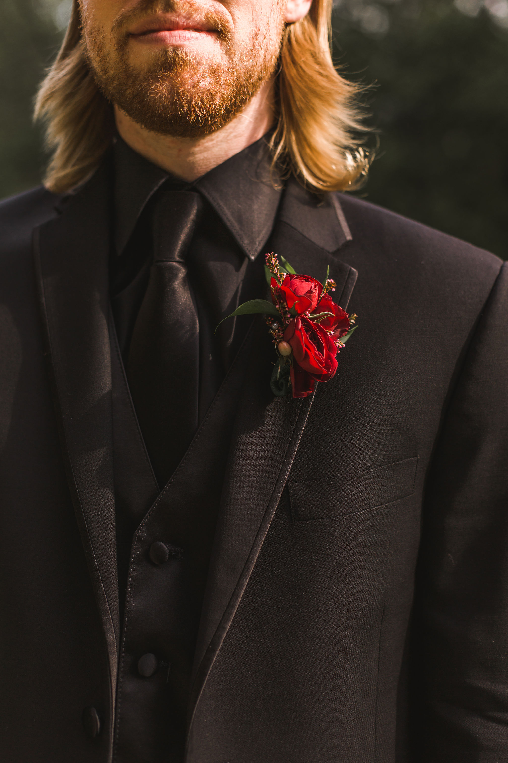 Wine red boutonnière