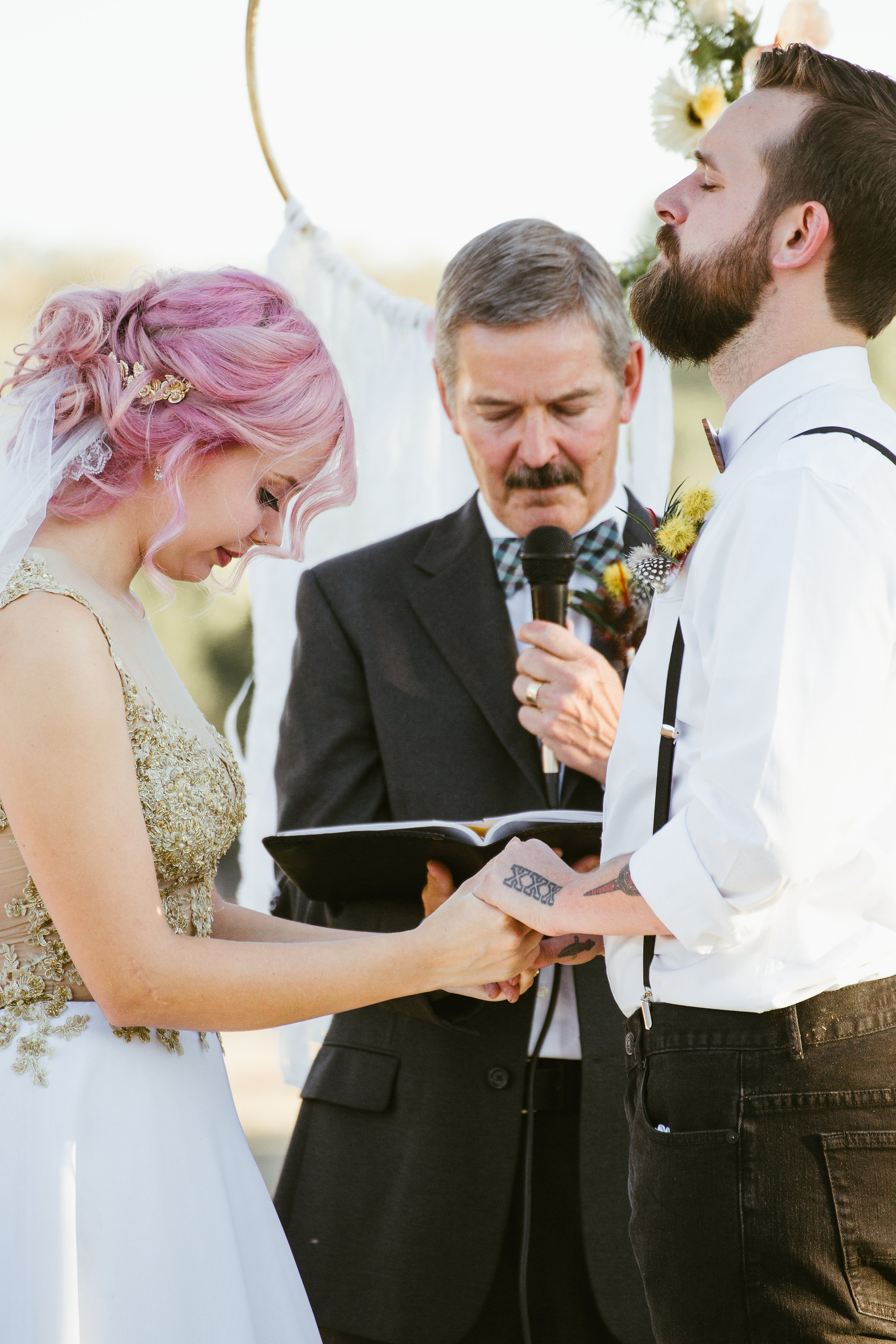 California barn wedding ceremony Bride with pink hair and gold dress