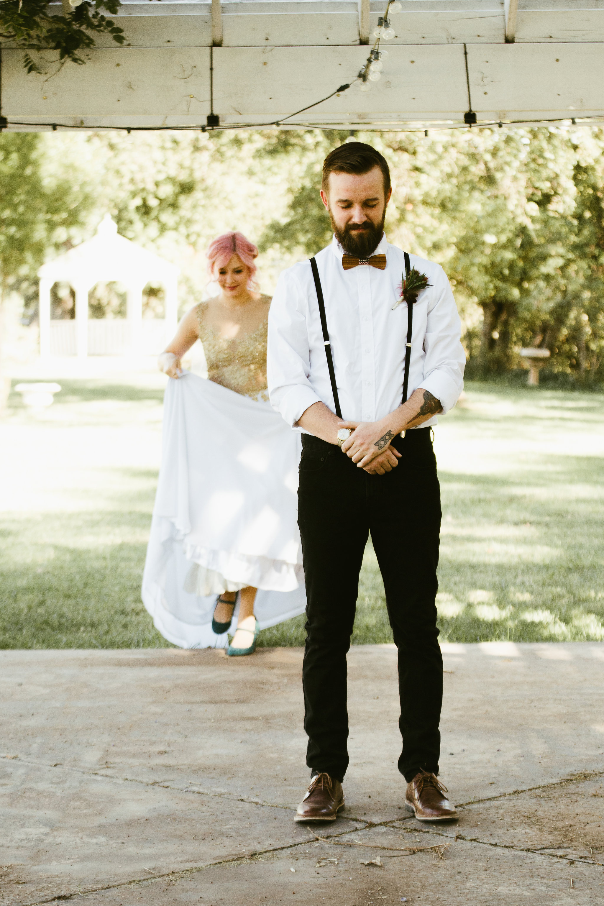 First look, Bride with pink hair and gold wedding dress