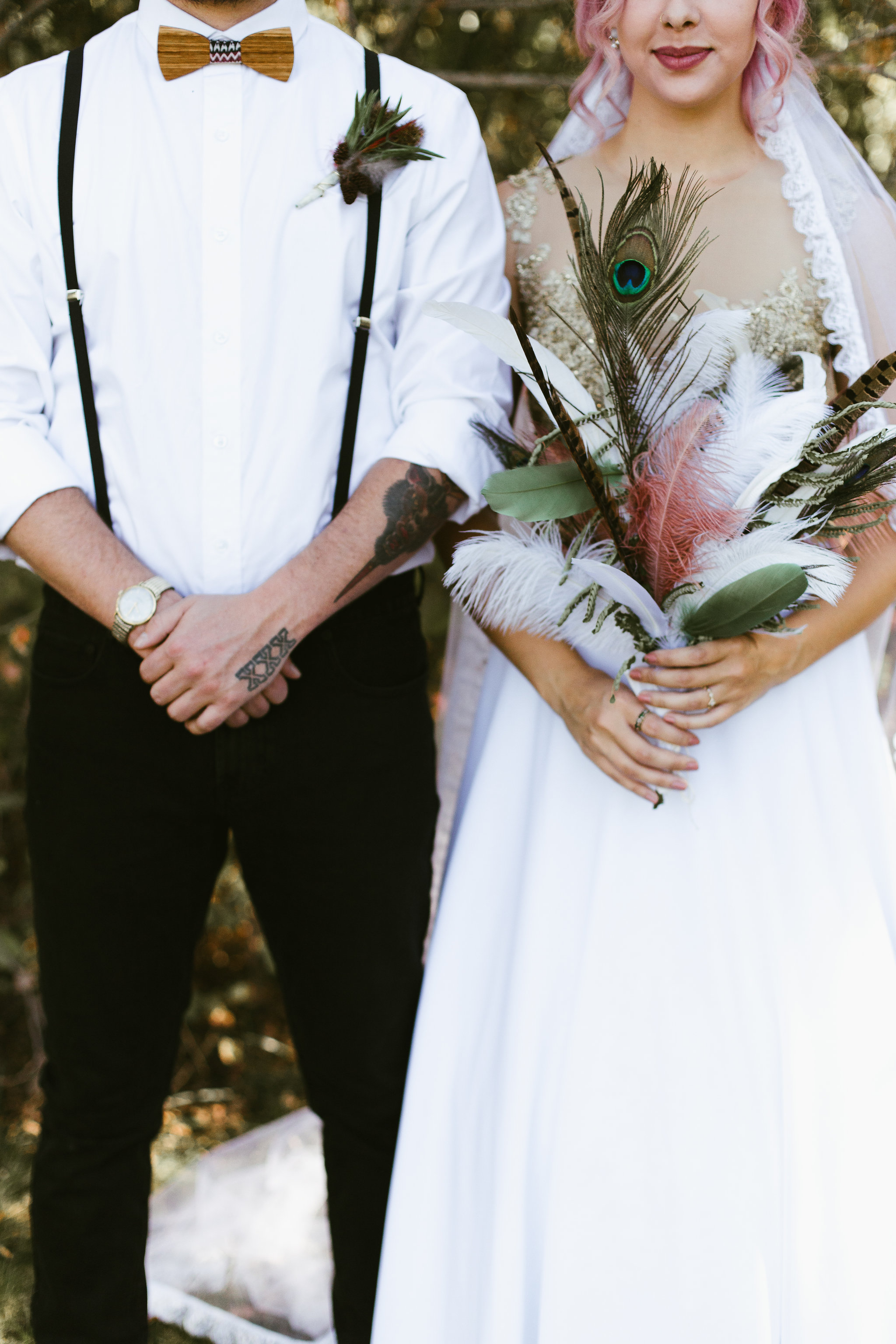 Groom with tattoos and Bride with pink hair and gold wedding dress