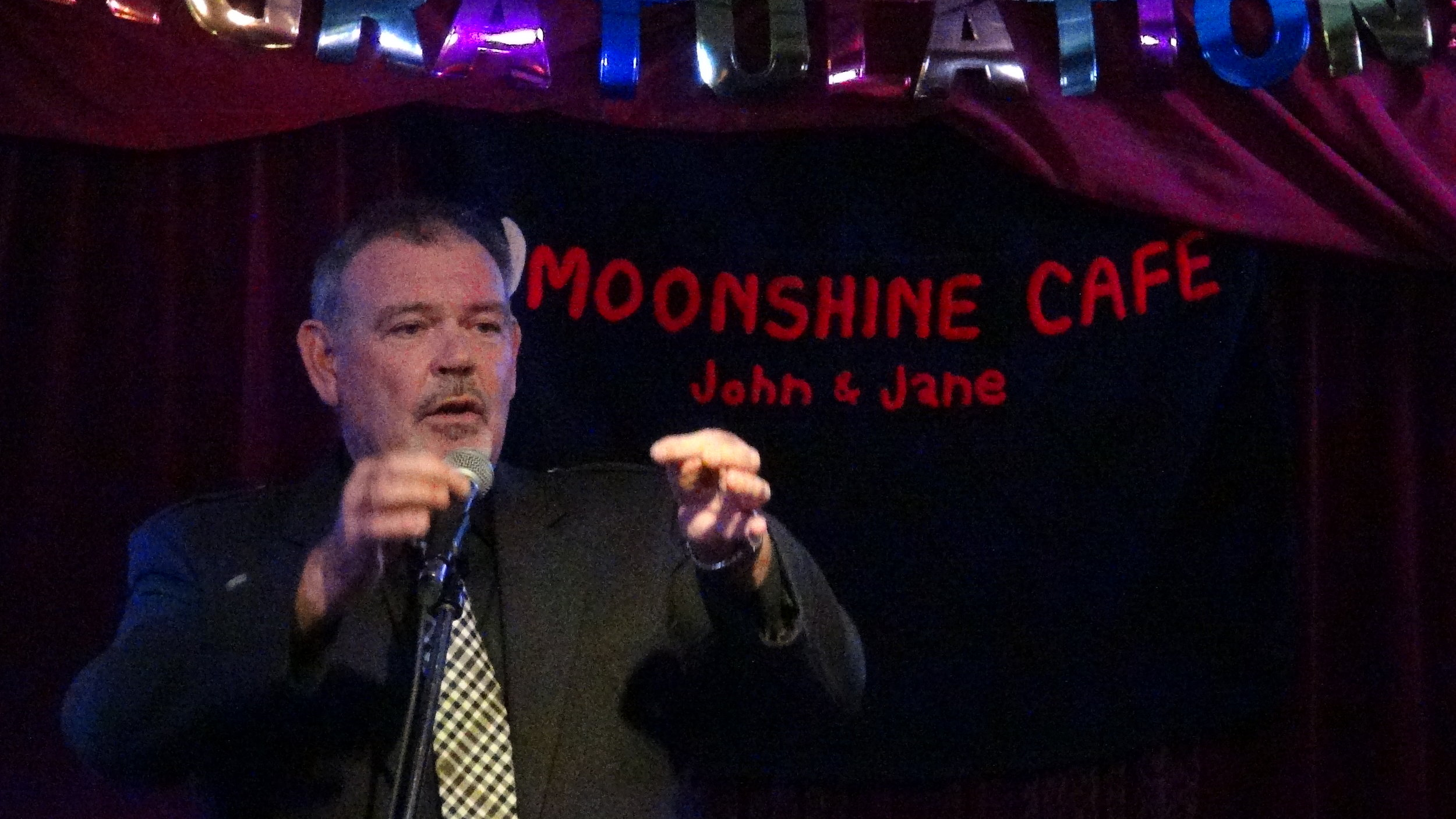 Featurette Artist  Ronnie O'Byrne , who has performed throughout the UK, Australia, and Canada, delivers a side-splitting performance with his signature satirical Scottish wit.