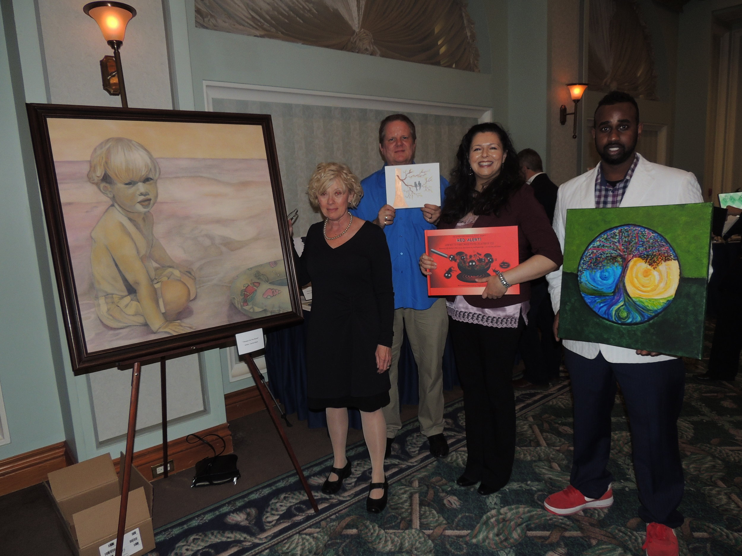Group of Four artists: Carrie Hind, Gary Woyotowich, and  Artis 3  cover artist, Abel Mekonnen, standing with children's author Anjula Evans. Photo by Mira Louis.