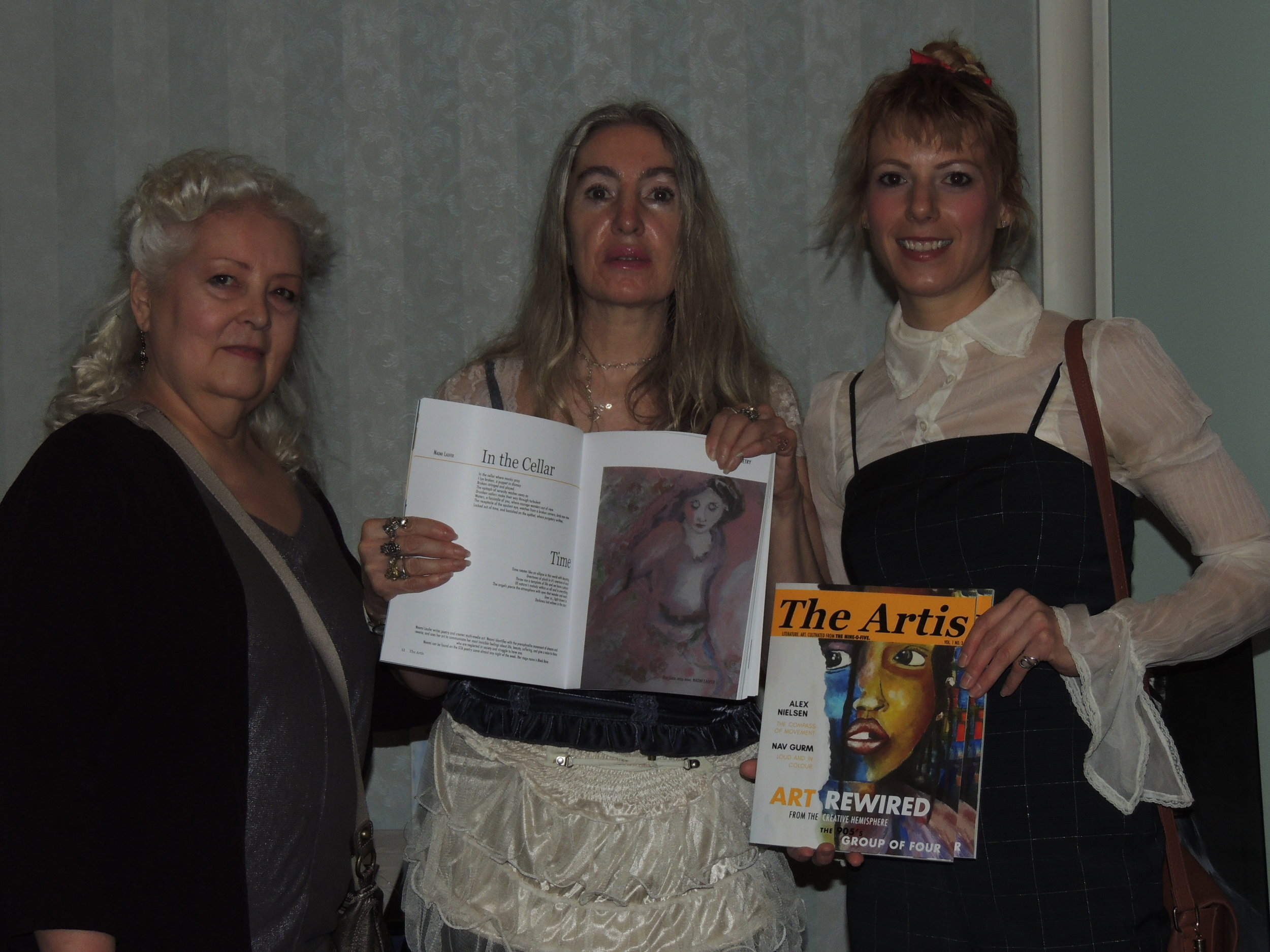 The Artis 3  contributing artist Naomi Laufer (centre) shows off her art, with fellow artist Susan & Editor in Chief Ivy Reiss. Photo by Mira Louis.